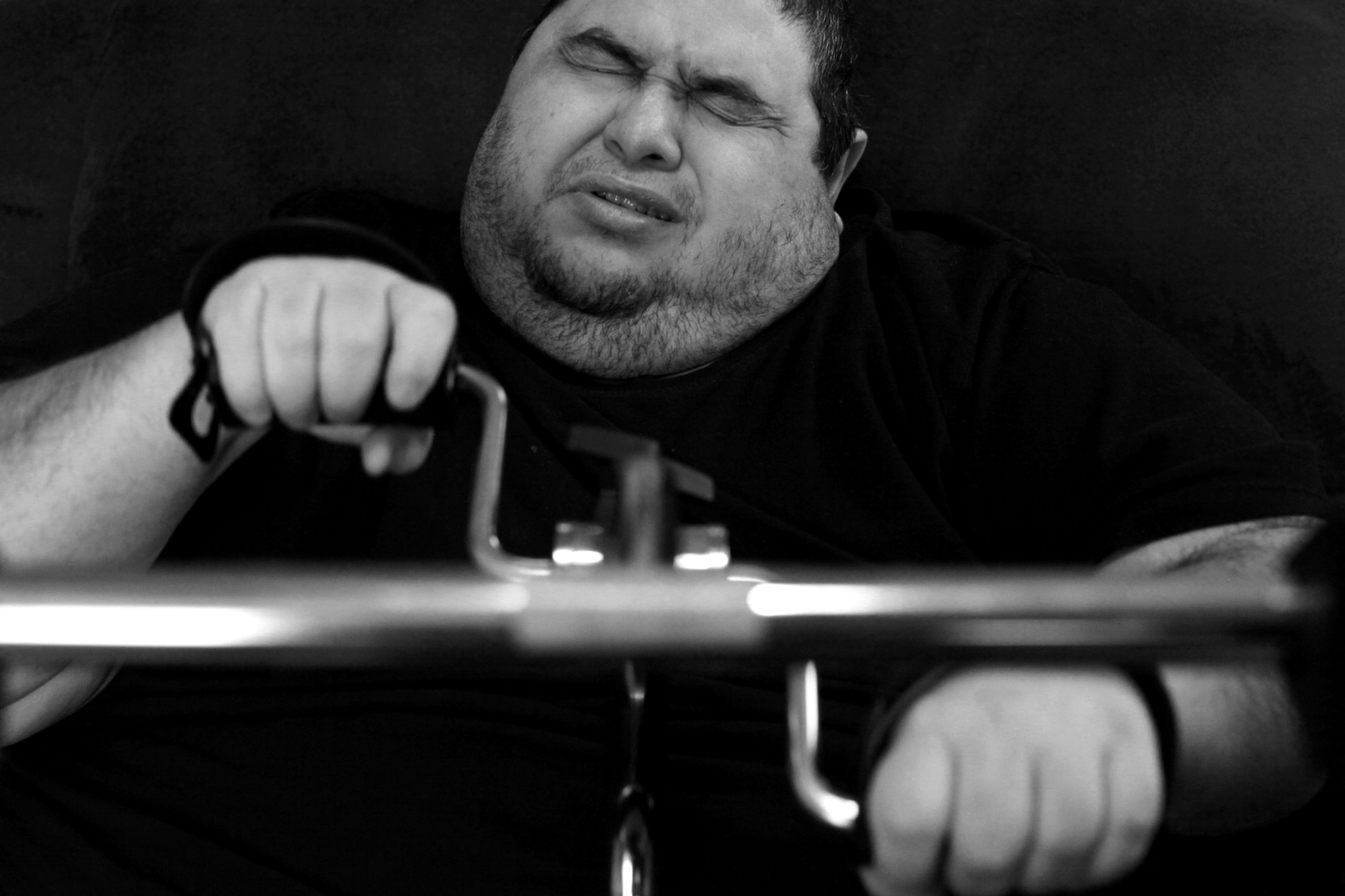 Hector Garcia Jr.uses a upper-body pedal exerciser at his home. Unable to leave the house or walk without the aid of a walker and wheelchair, Garcia had to figure out different ways to burn calories. © Lisa Krantz/San Antonio Express-News/ZUMA Press