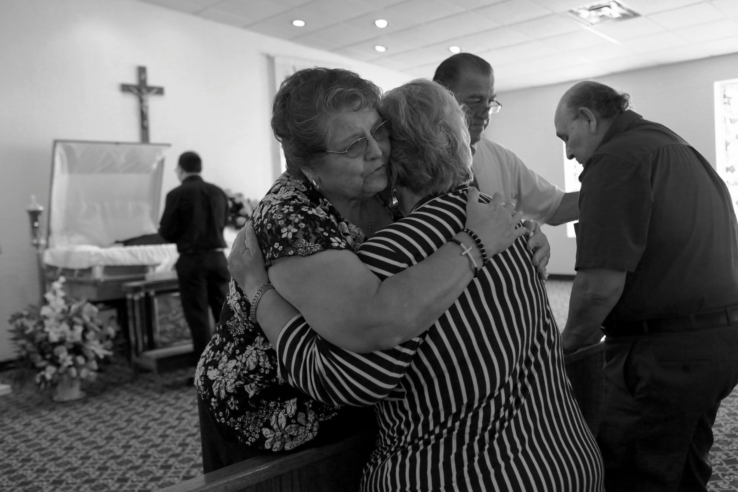 Elena Garcia and Hector Garcia Sr., the parents of Hector Garcia Jr., are embraced by their best friends, Patsy and Ruben Villarreal, during the private viewing for their son at Trevino Funeral Home Palo Alto. © Lisa Krantz/San Antonio Express-News/ZUMA Press