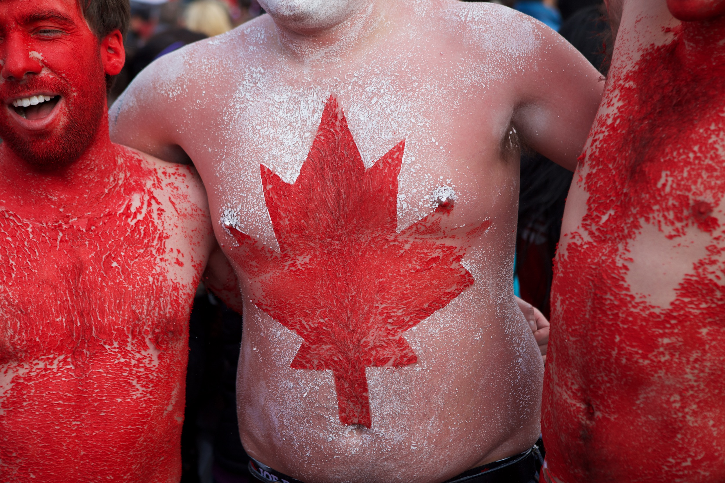 Fans celebrate Canada's Olympic gold medal men's hockey victory over the United States at Robson Squire in the streets of downtown Vancouver.© Sol Neelman