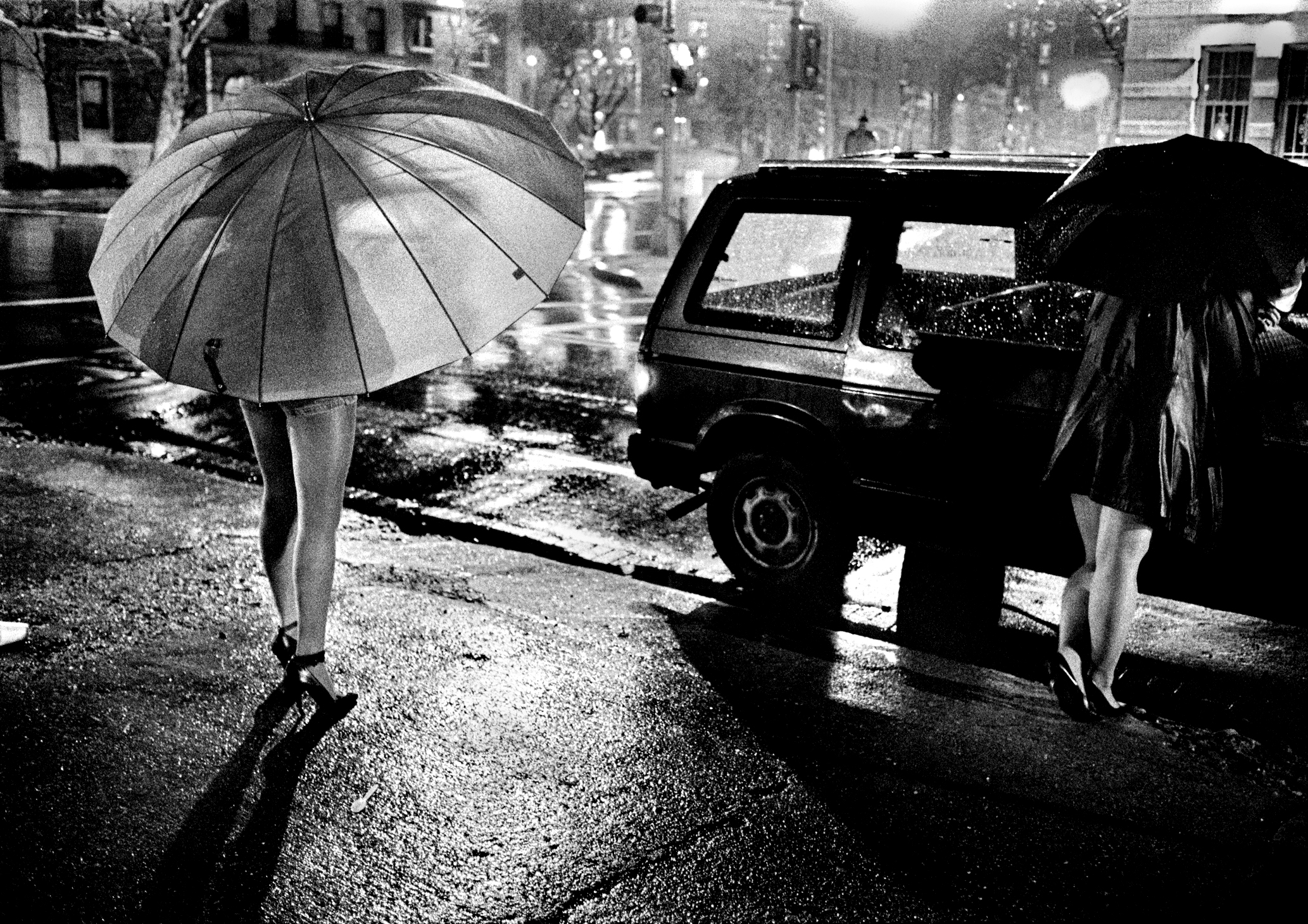We were doing a story on a new program that tried to get prostitutes off the streets and I had spent days and days trying to photograph these women, finally on a rainyday they agreed because of the umbrellas.© Nancy Andrews/The Washington Post