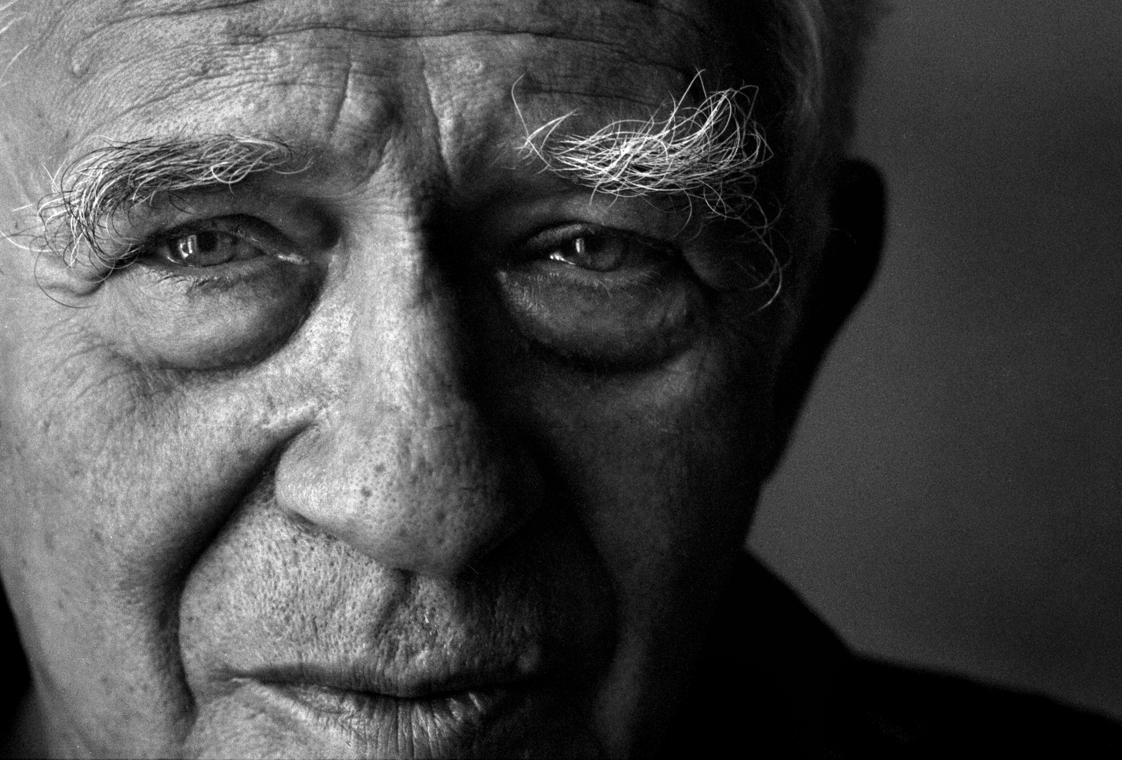We often had to shoot quick portrait in hotel rooms of visiting authors on book tours. This is simply window light and incredible eyebrows on Norman Mailer's face.© Nancy Andrews/The Washington Post
