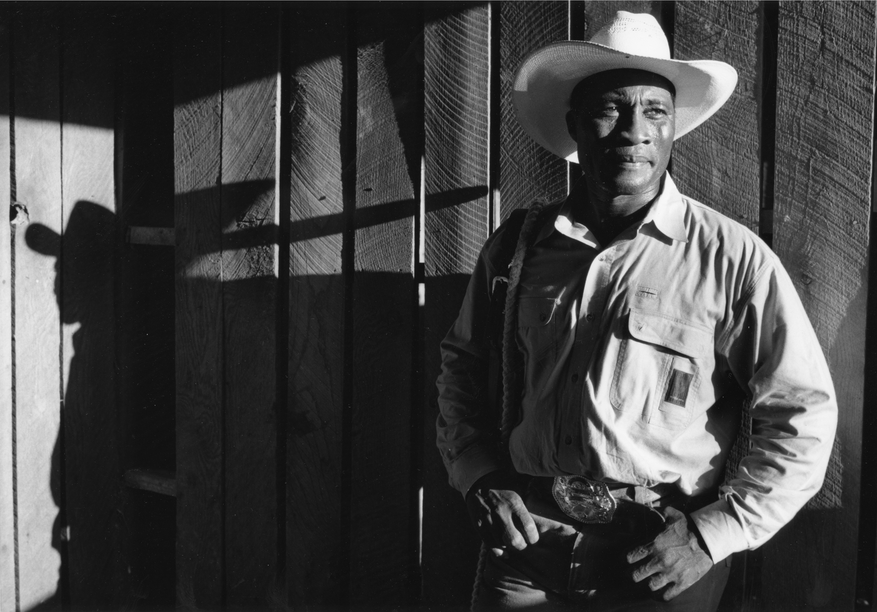 """FAMILY: A Portrait of Gay and Lesbian America: Cowboy T. J. Smith from Okalhoma was photographed on the gay rodeo circuit in 1993. People used to look at his picture and question, """"He's gay????""""© Nancy Andrews"""