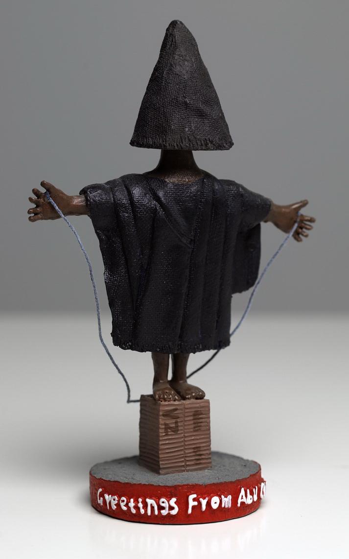 "From America the Gift Shop: Abu Ghraib bobble-head figurine. Molded resin, 7"", 2008 © Phillip Toledano"