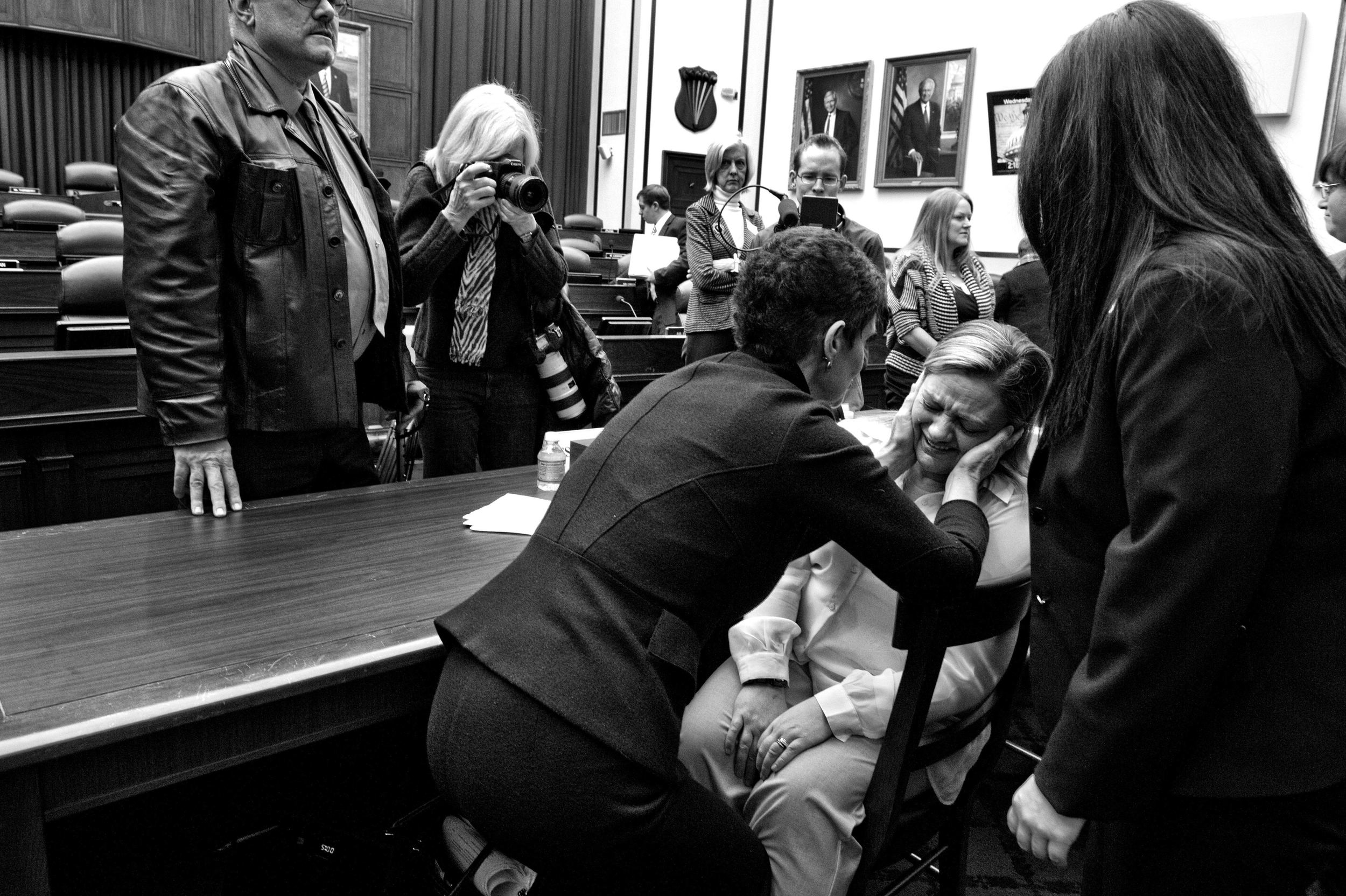 The War Within:  TSgt. Jennifer Norris, who was drugged and raped by her recruiter after joining the US Air Force when she was 21-years-old, is comforted by Nancy Parrish, President of Protect Our Defenders, as she breaks down after testifying before the House Armed Services Committee hearing on Capitol Hill.  © Mary F. Calvert/ ZUMAPRESS.com