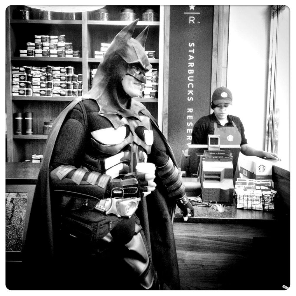 iPhone Work:   Batman at Starbucks. © Mark Peterson/   ReduxPictures
