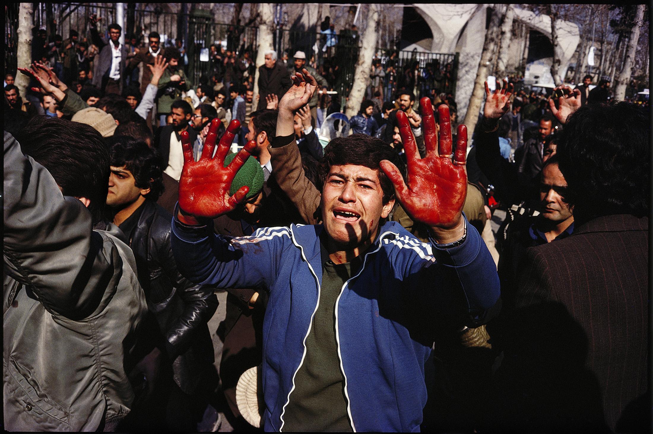 "The blood of the latest ""martyr"" — near the University. Tehran, January 31, 1979.© 2015 David Burnett/Contact Press Images"