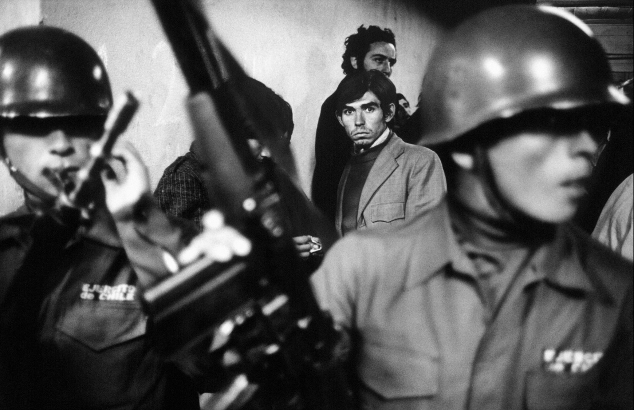 """Daniel Cespedes, a suspected """"leftist"""" is taken to the National Stadium after his arrest in the aftermath of the September 11th Chilean coup, Santiago, Chile, September 1973. © 2015 David Burnett/Contact Press Images"""