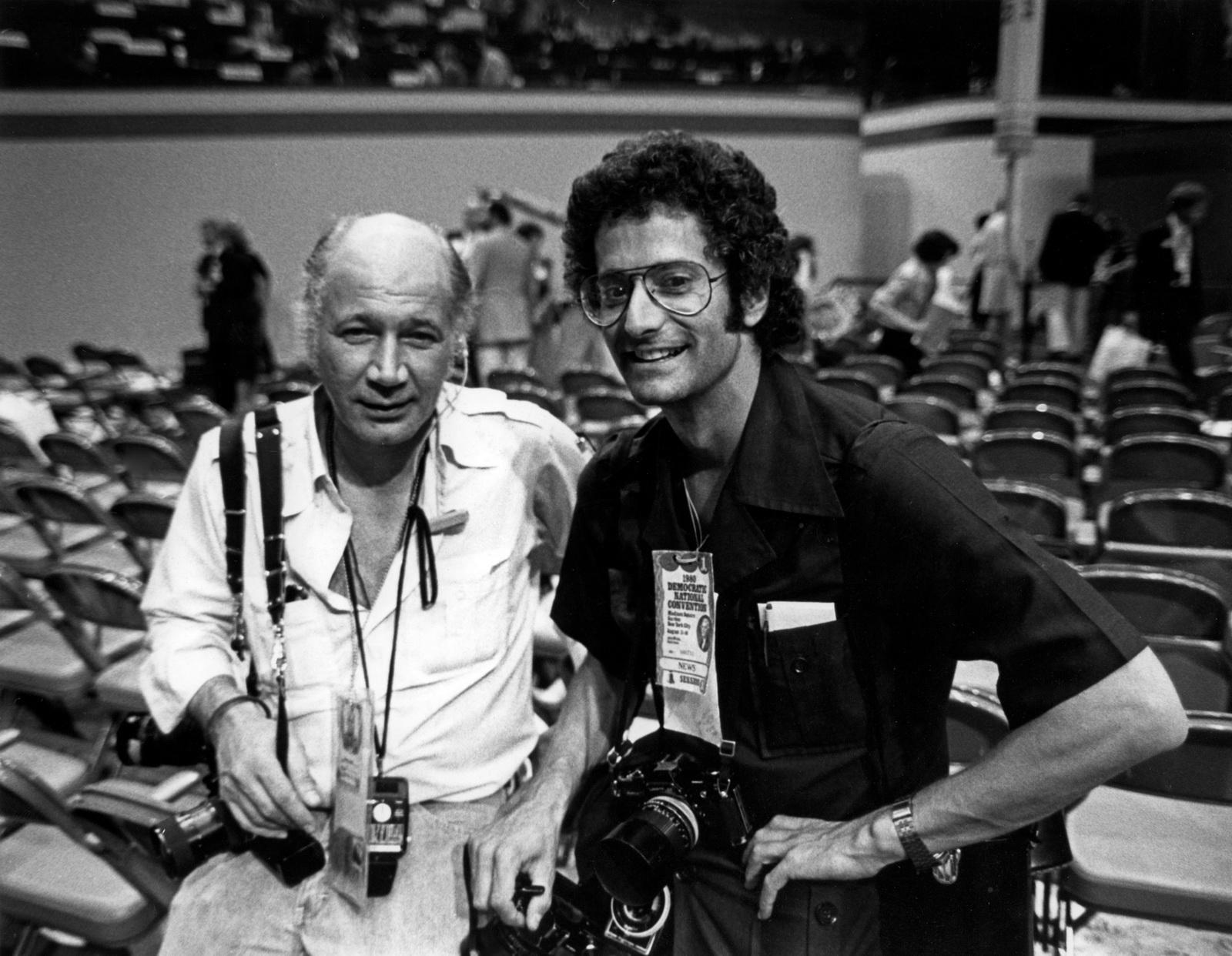 Eddie Adams and David Burnett at the 1980 Democratic Convention. © Keith Skelton