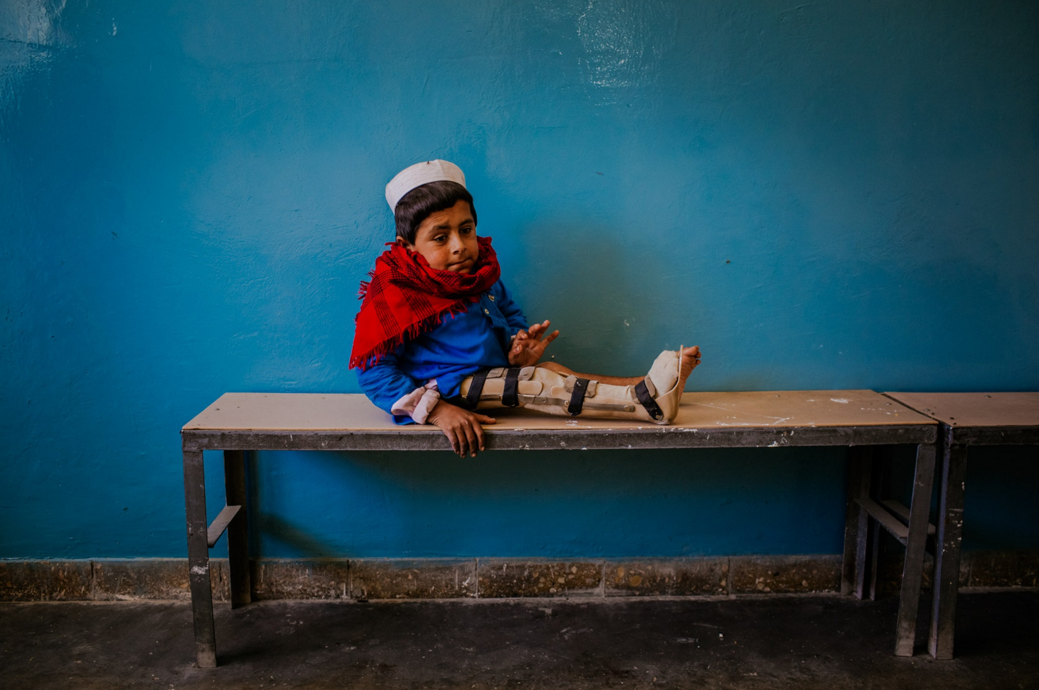 Bismillah Gul, 12, suffering from poliomyelitis waits for his father Masta Gul, after having traveled from Khost province to get treatment at the International Committee of the Red Cross (ICRC) orthopedic center in Kabul, Afghanistan. November 19, 2012 © Daniel Berehulak/Getty Images