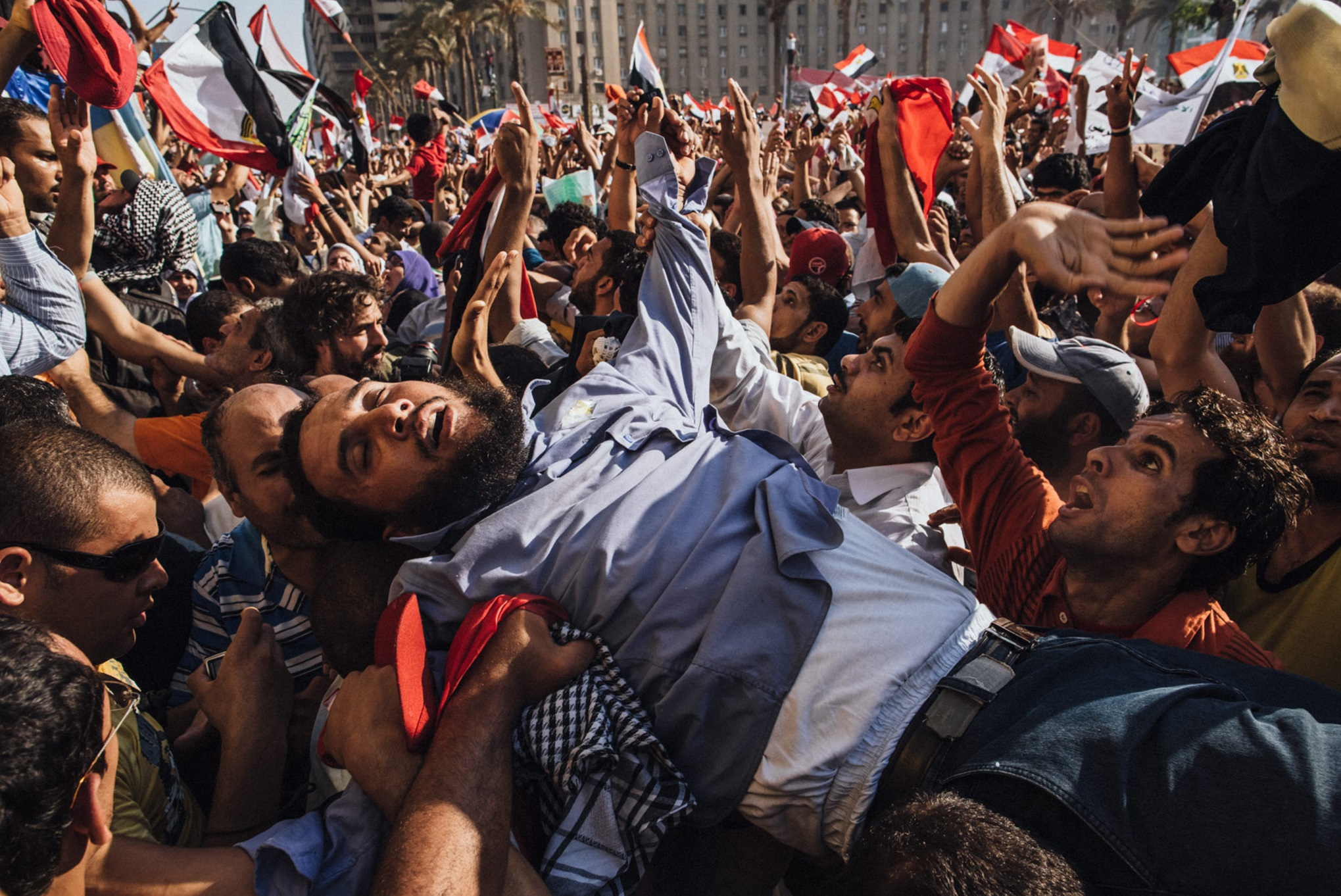 A supporter of the Muslim Brotherhood overcome by emotion is carried onto the stage as Egyptians celebrate the election of their new president Mohamed Morsi in Tahrir Square in Cairo, Egypt. June 24, 2012  © Daniel Berehulak/Getty Images