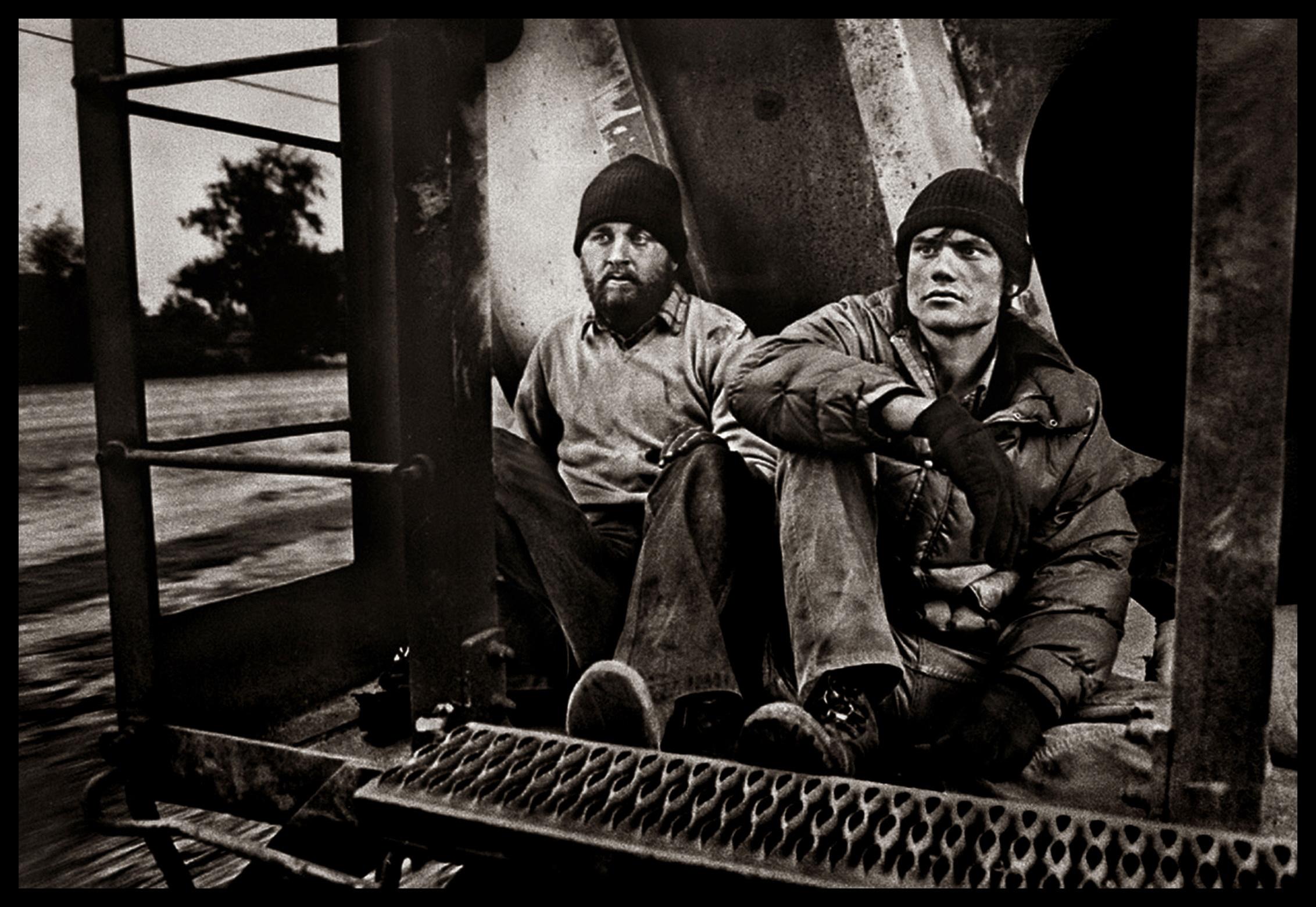 Photographer Michael S. Williamson (L) and writer Dale Maharidge ride the rails near Fresno, California in March 1982. © Michael S. Williamson