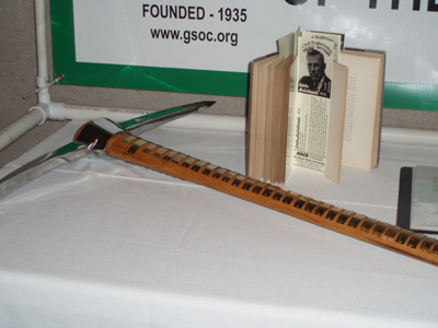 Photo of the GSOC pickaxe and    The Two Islands    taken during the 2010 GSOC banquet.