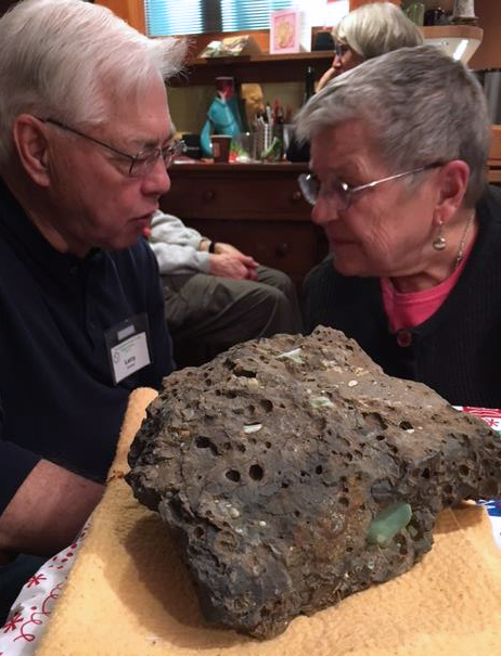 Larry and Bev confer next to the Christmas rock found in the Columbia Gorge by Cris.