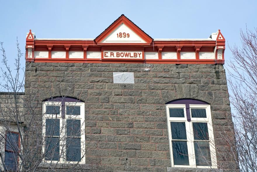 Bowlby Stone on the Bowlby Building in Enterprise was created in the Wapshilla Ridge flow. Photo by Ellen Morris Bishop.