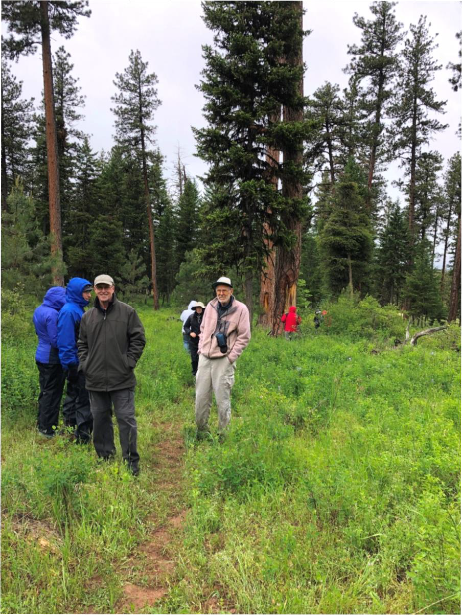 The field trip guide for this part of the trip was photographer Dave Jensen (tan outfit in the center), who took the group to a grove which was an ancient camp of the Nez Perce tribe.