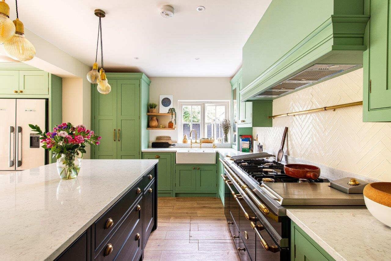 Green and black shaker kitchen with range cooker and butler sink