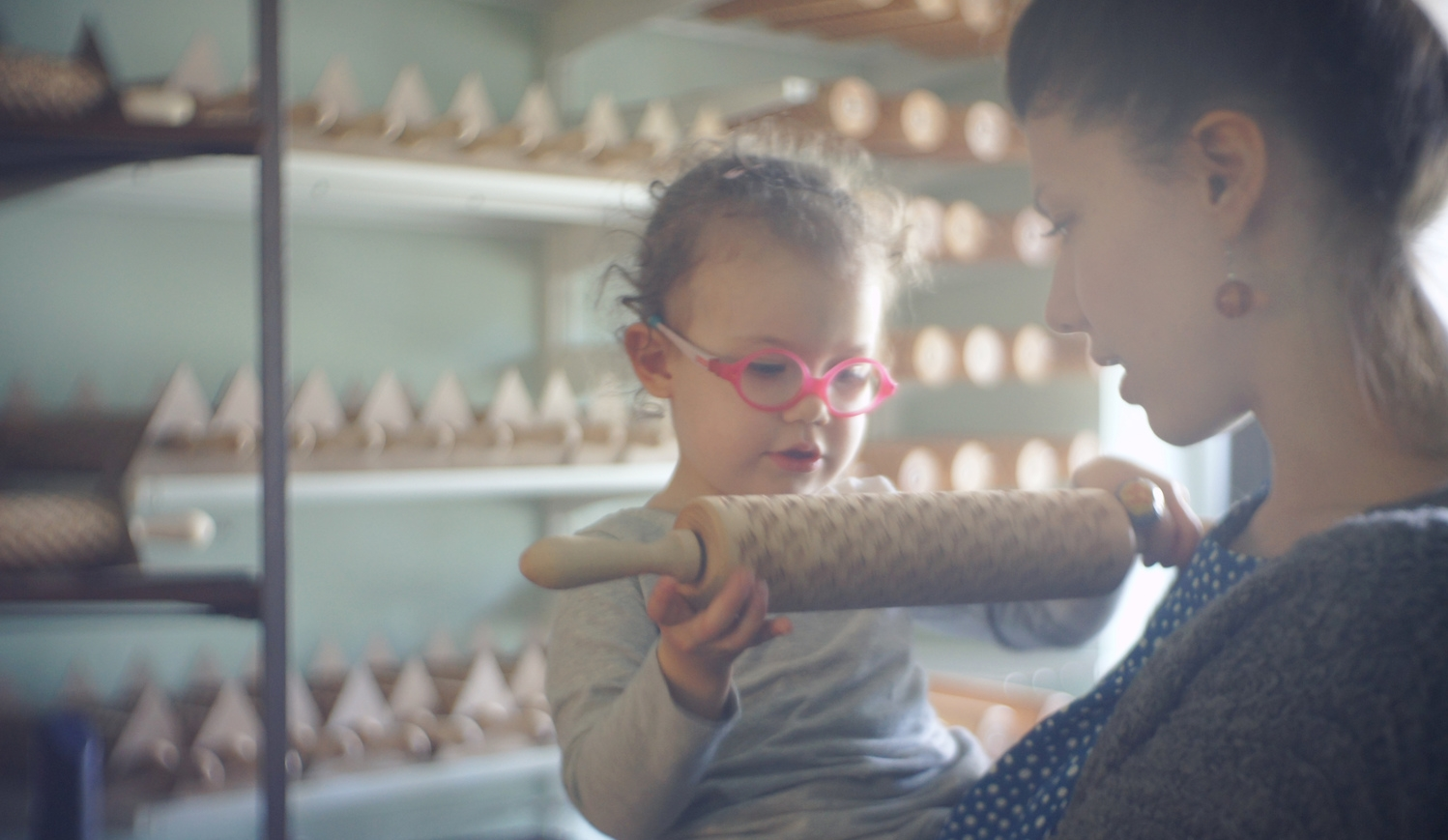 My niece inspecting the quality of one of my cats rolling pin