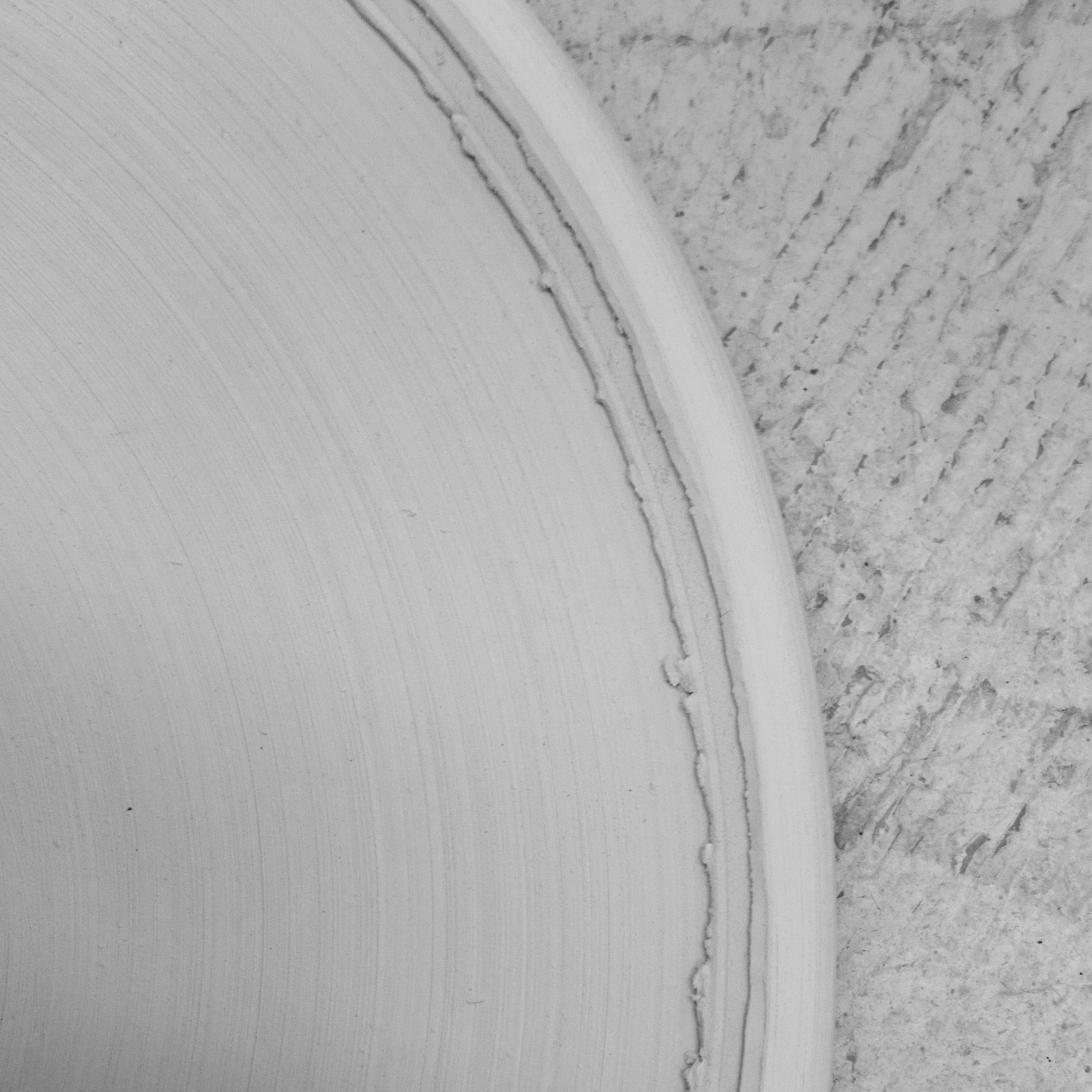 The flat plates have a rough edge that was developed partly with experimenting directly in clay.