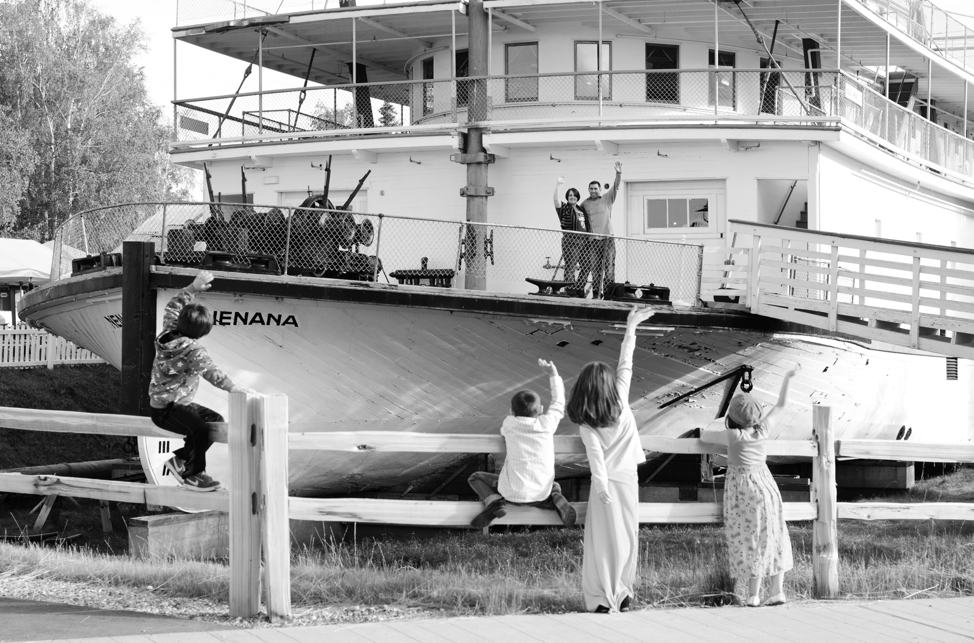 kids waving to parents on boat - pioneer park fairbanks ak