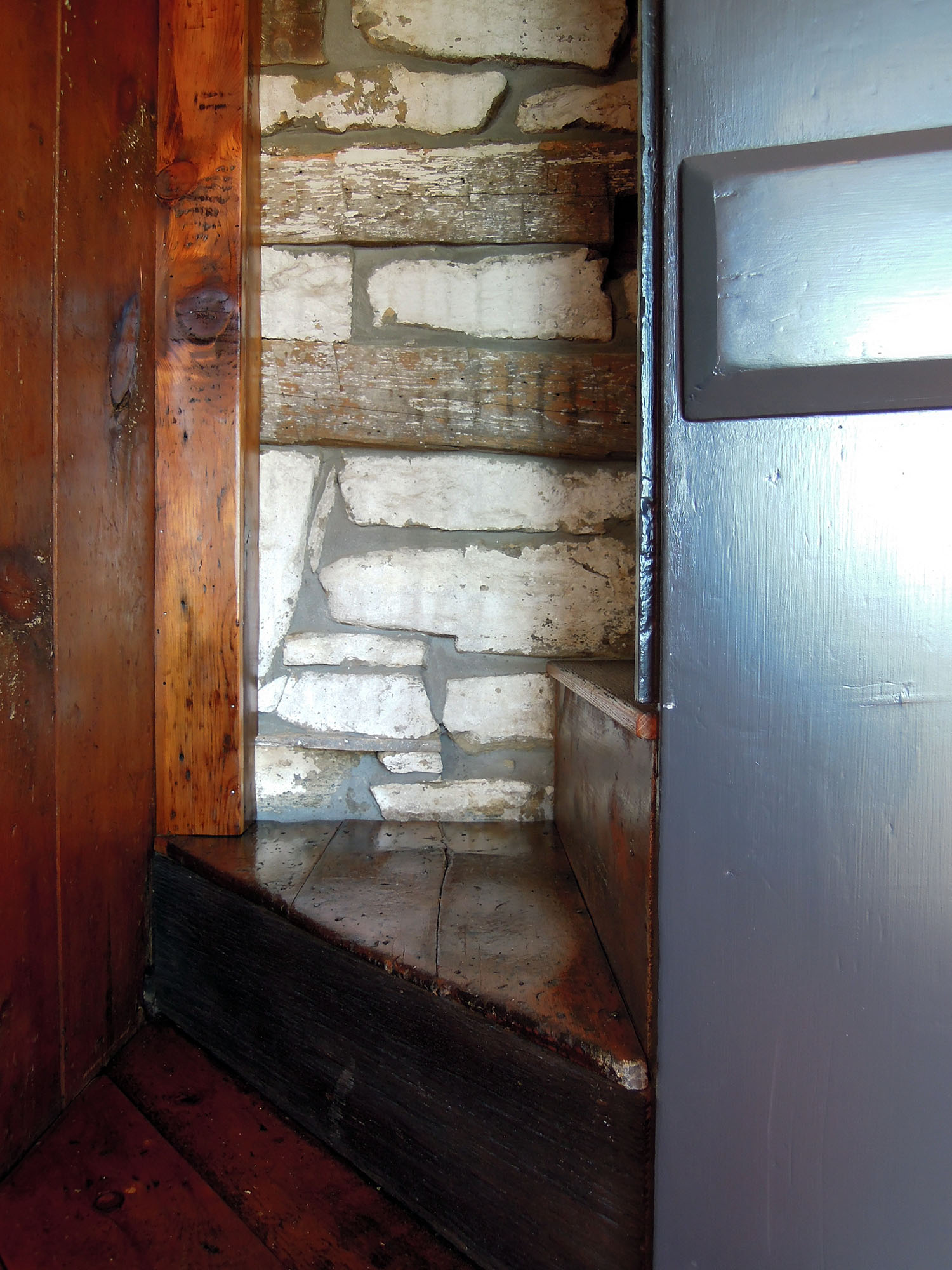 This old set of stairs was unused and not structurally sound. We modified the stairs and in the process found this great section of the chimney exposed in the staircase.