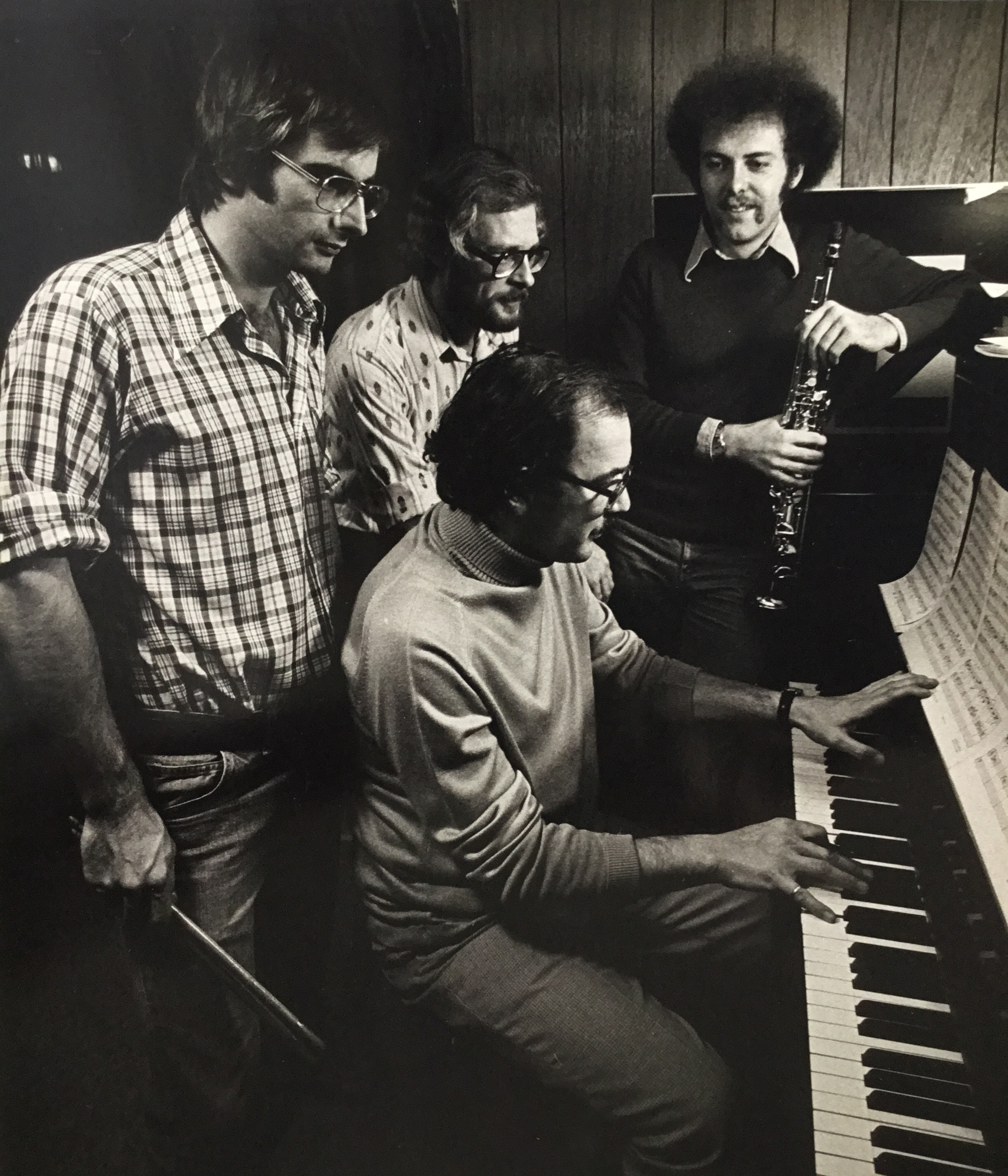 "A 1976 version of JAZZART taken during a rehearsal for a series of library concerts. Personnel (l to r): Mike Pihura (drums); Doug Wicken (bass); Barry Wills (piano); Brian Tansley (saxes). Photo by Doug Wicken (an early version of a ""selfie"")"