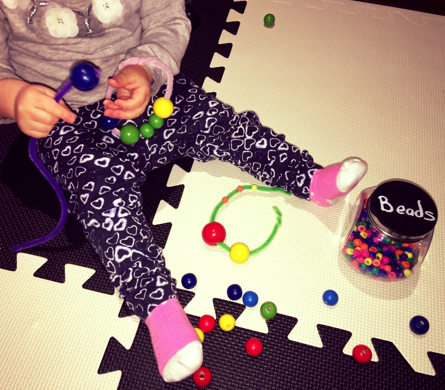 Not only is this a great activity for motor skills, you can also use it to match and sort (beads of the same size or colour) and it helps them learn to stay focused.