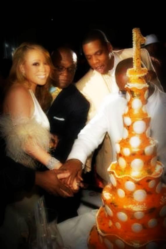 16-mariah cutting cake.jpg
