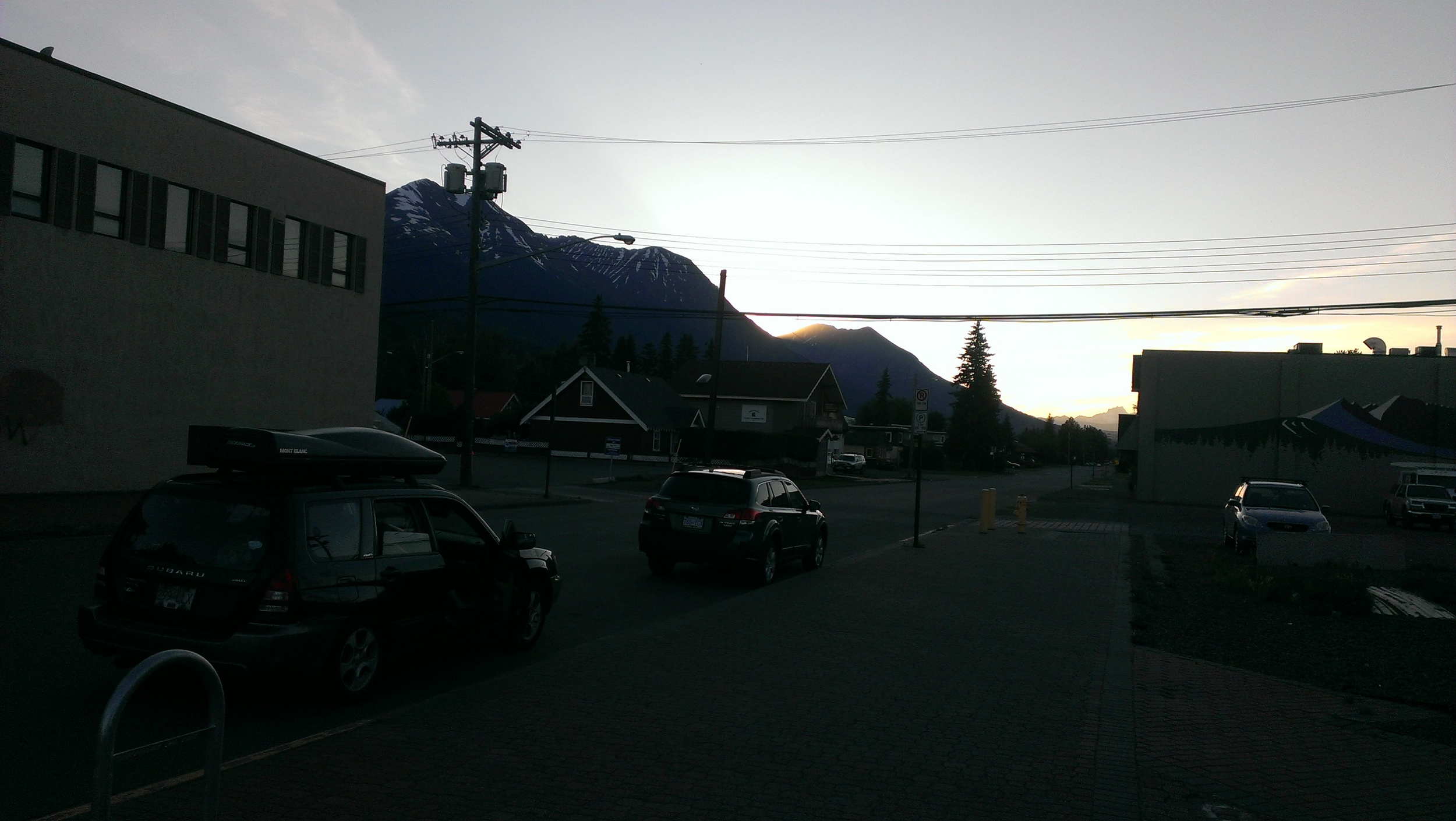Sun setting behind the mountains. View from Smithers.