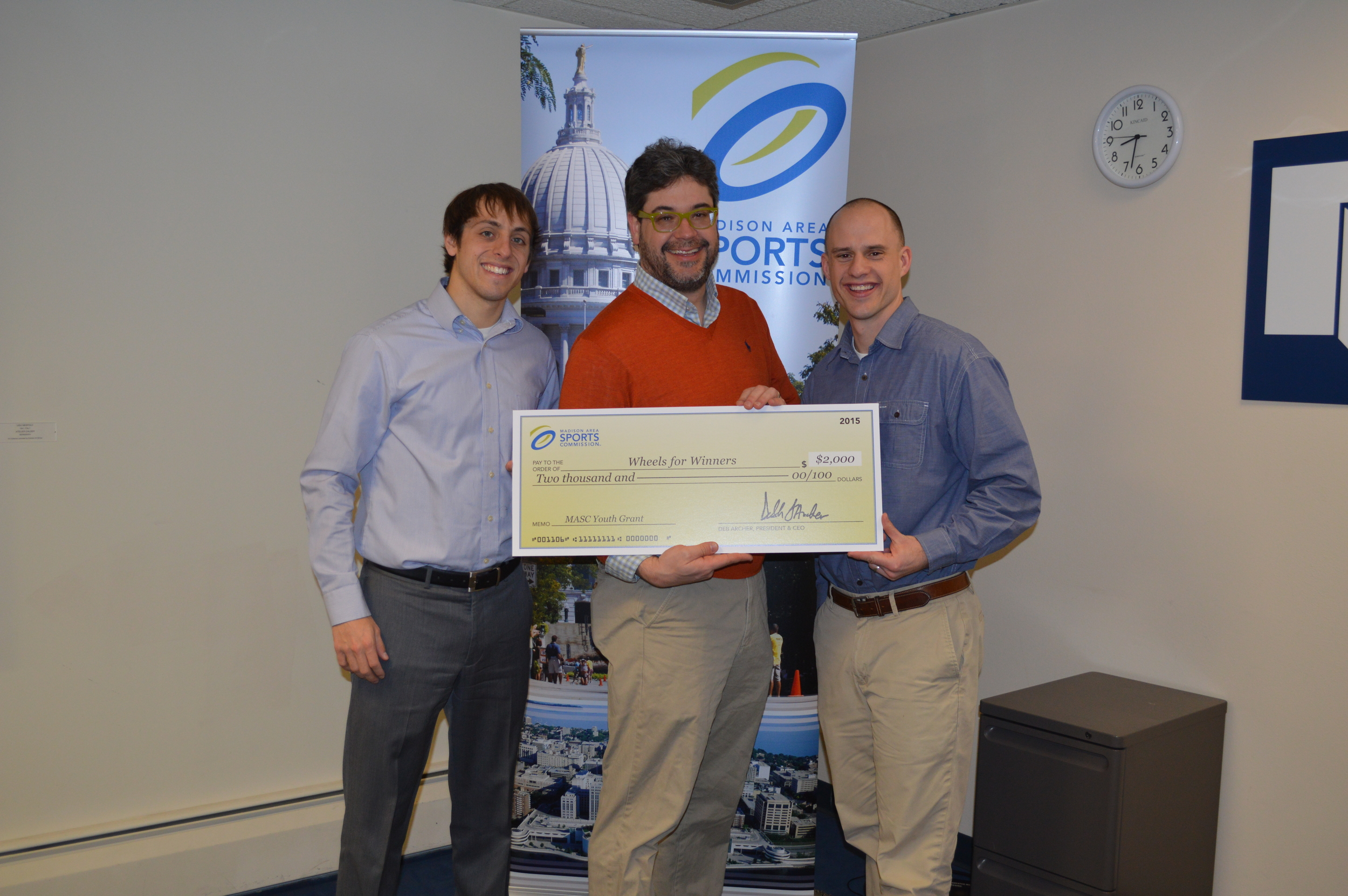 A big thanks to the  Madison Area Sport Commission  for choosing Wheels for Winners as one of the recipients of this year's youth grant. Pictured from left to right: Brandon Holstein (MASC Account Manager), Stephen Bagwell (Wheels for Winners President), and Jamie Patrick (MASC Vice President).
