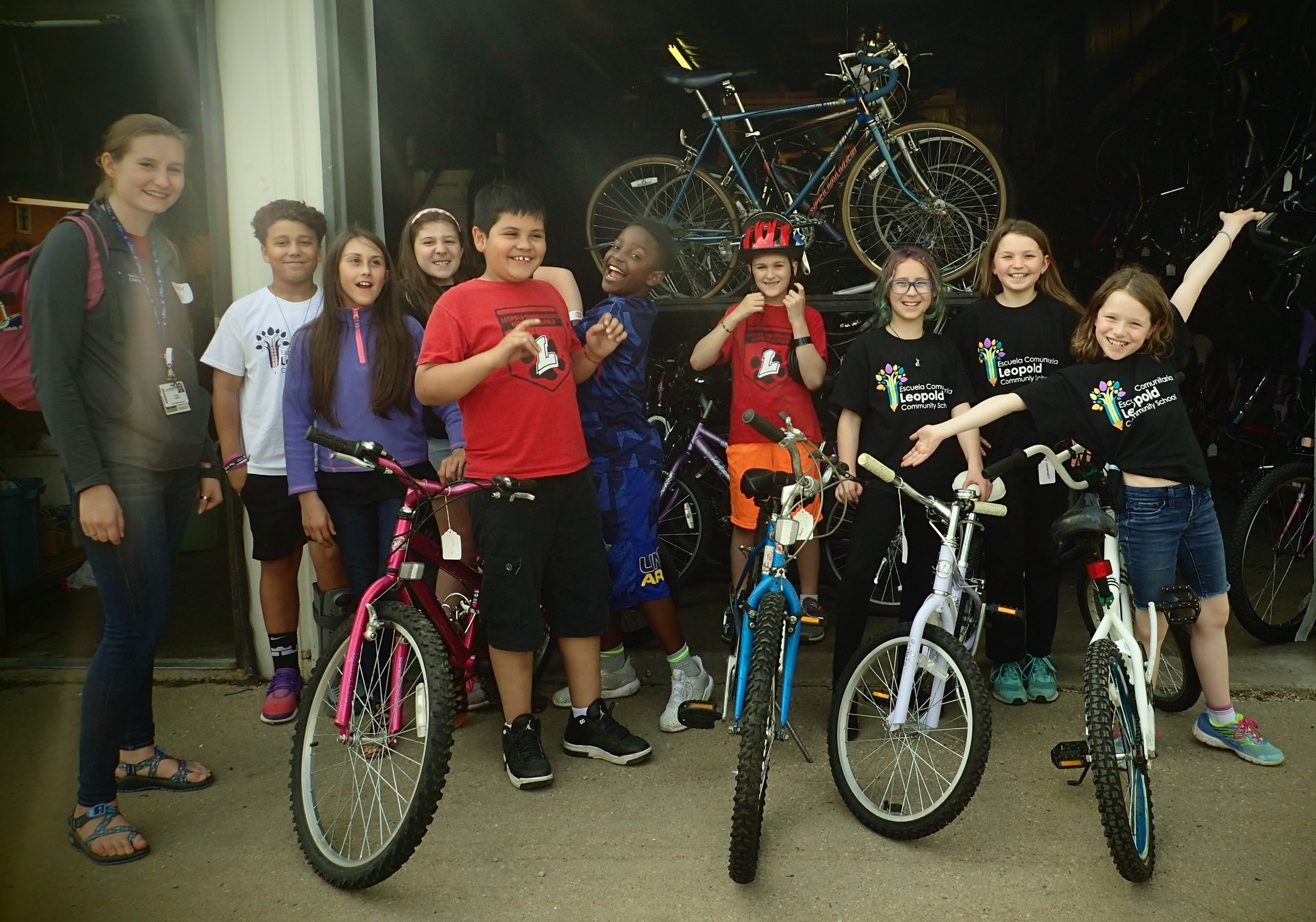 """The students in the Leopold Student Advocacy Team (self-named Leopold Community Leaders) came by to pick out their bikes today. They are students that were selected by their teachers as being influencers in the classroom. The goal of the club is to identify things in their neighborhood that prevent people from being active, then do projects that address some of those needs. The projects that were identified this year include: traffic calming for bike to school day, painting lines for a football field behind the school, and painting benches in front of the school. In addition to their time in the group, the students are also responsible for doing community service outside of the club. The 3rd and 4th graders have been meeting with teacher facilitators of the club during their recess time to help with a variety of projects throughout the school, such as cleaning up garbage on the playground, shelving books in the library, and sorting recycling. The 5th graders are completing their additional service hours by participating in the """"Reading Buddies"""" program, where they meet with a kindergartner each week and read with them. Some of the students are also going above and beyond by doing service outside of the club by cleaning up garbage at their local park, cleaning up dog poop at the dog park, and even making blankets for animals at shelters!"""