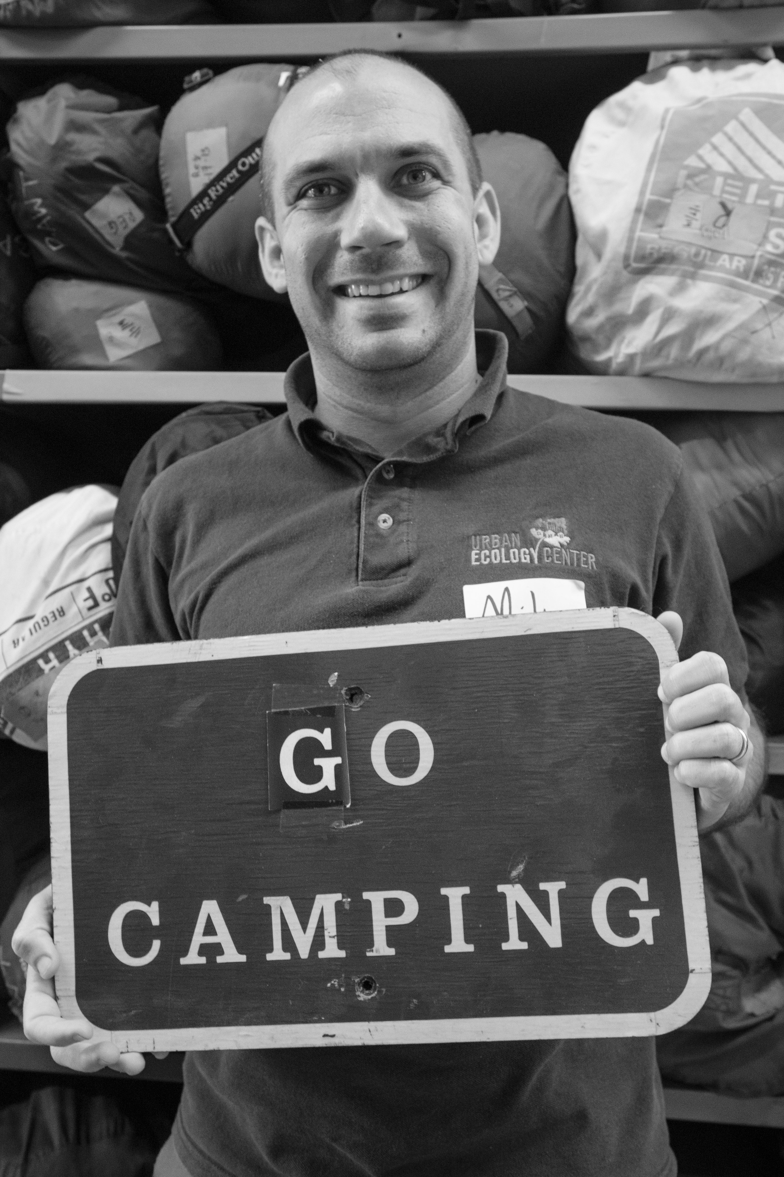 Mike from the Urban Ecology Center in Milwaukee poses with a favorite sentiment - go camping!