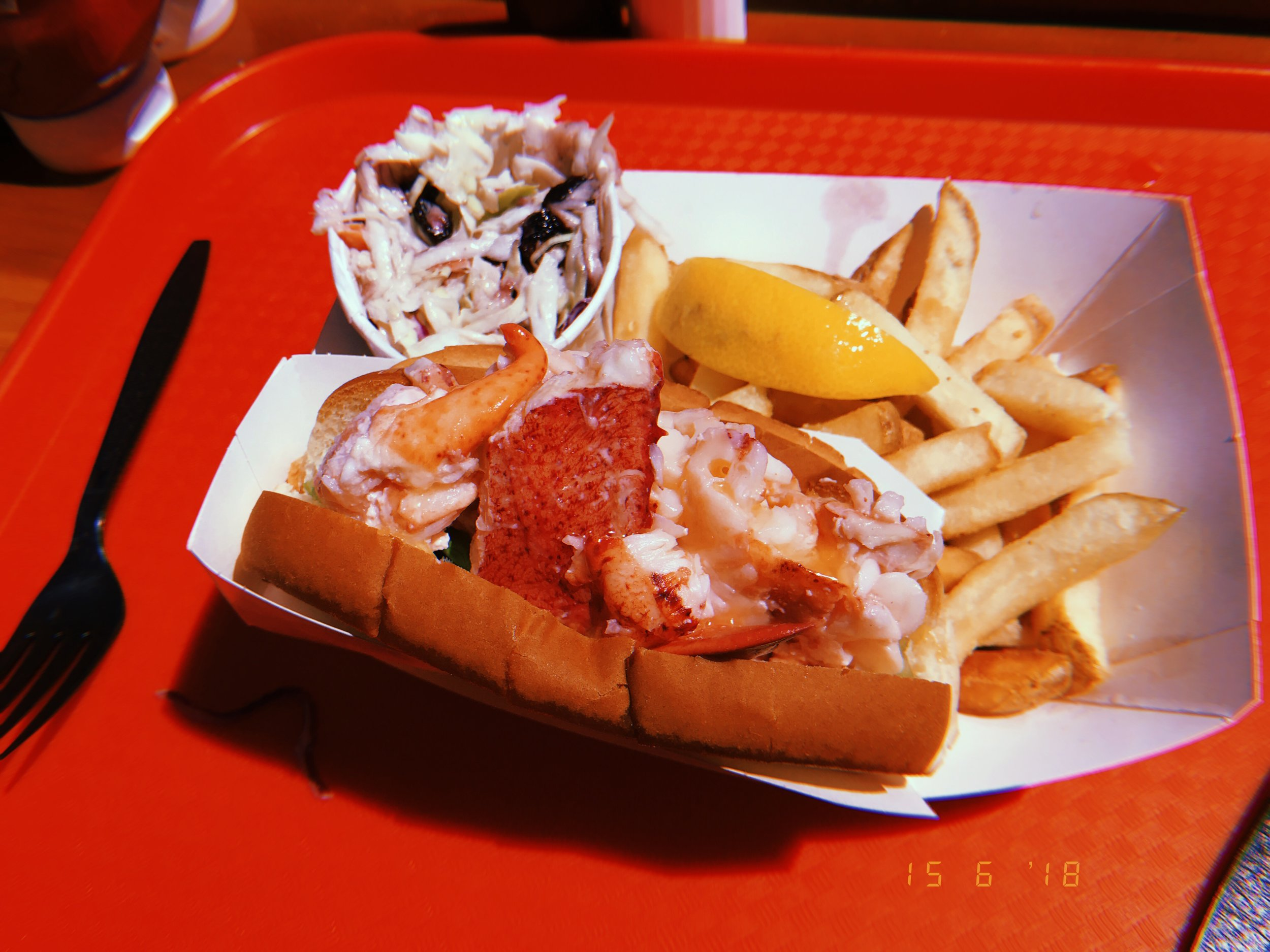 Arguably New England's most famous food: The Lobster Roll! A toasted bun with a light spreading of butter and mayo topped off with the juiciest cold lobster meat. Heavenly!