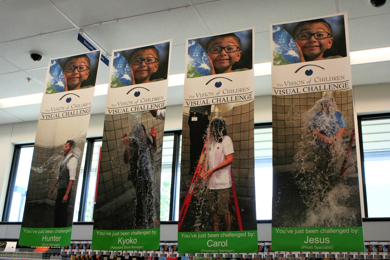 VOC Visual Challenge banners hanging in Walgreens' Encinitas location
