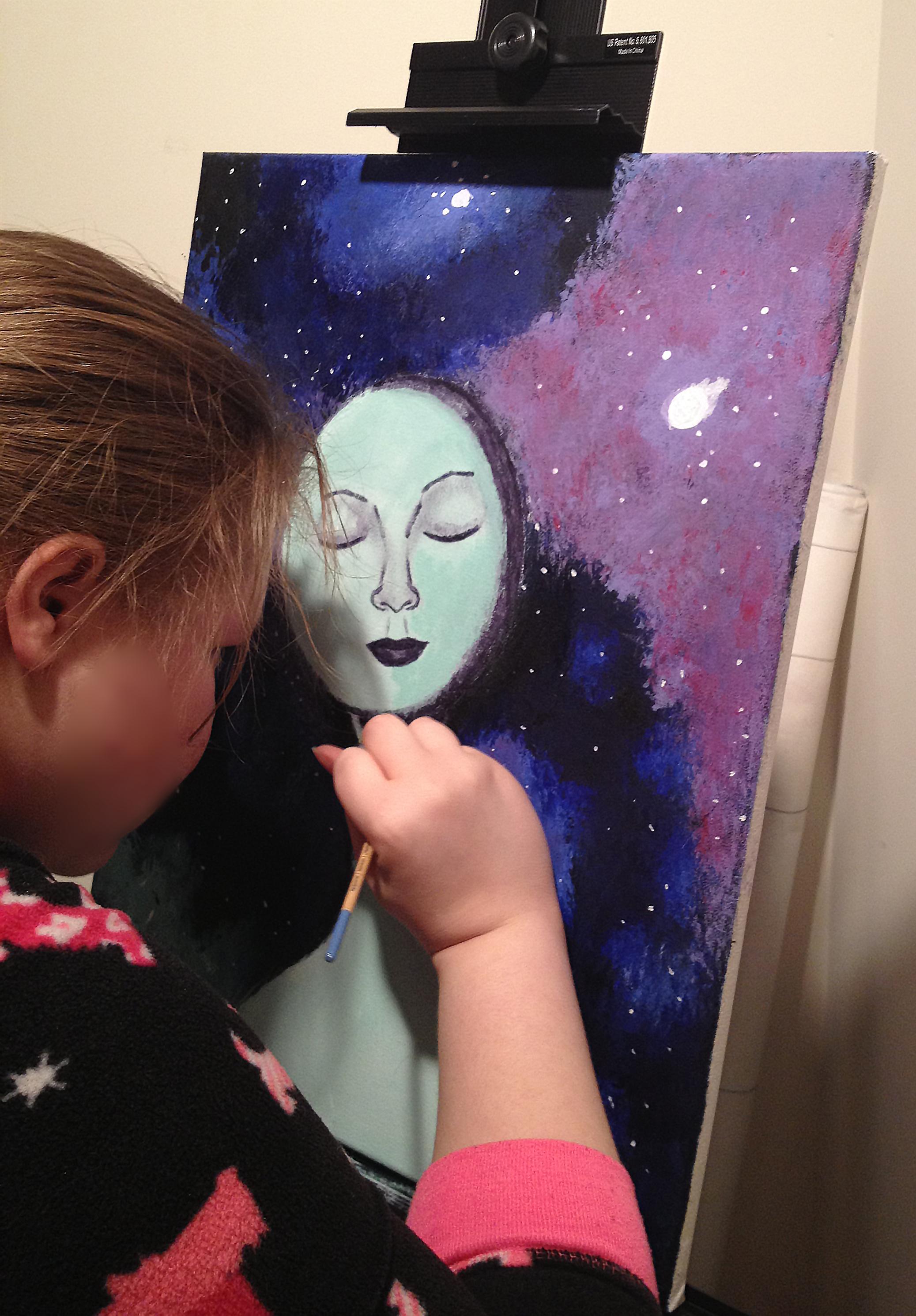 Lauren working on one of her paintings.