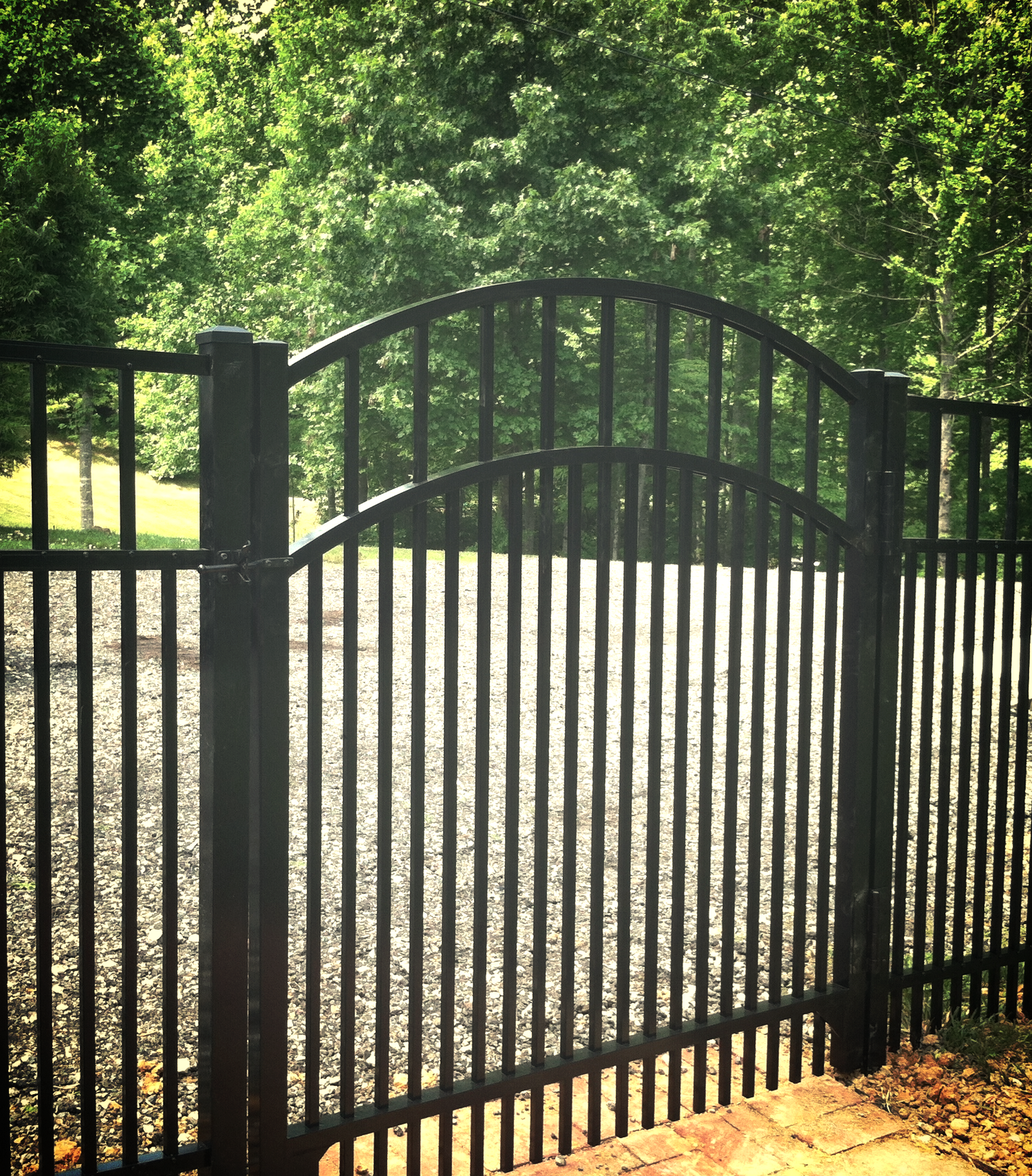 Arched Aluminum gate with puppy pickets for the small dogs