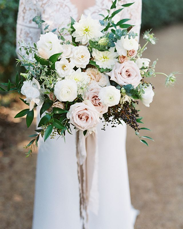 June's & her bridal party with sweet timeless bouquets, wrapped in @tonoandco silk ribbons, featured on @stylemepretty Photography: @thismodernromance | venue: @monarchbresort | Planning and Event Design: @roandcoevents | Floral: @lavendersflowers | Videography: @thehubsfilms | Dessert: @sweetleemade | Strings: @naplesstrings | DJ: @redshoela | Specialty rentals: @sigpartyrentals | Tabletop rentals: @borrowedblu | Table Linens: @latavolalinen | Specialty linens and ribbon: @tonoandco | Stationery and Paper Goods: @aerialistpress | Escort Card Pins @larkandives | Bride's dress: @sarahseven | Hair and Makeup: @studiommb | Groom and Groomsmen attire: @theblacktux | Bridesmaid dresses: @vowtobechic | Bride's shoes: @gianvitorossi | Favors: @milkbarstore #lavendersflowers #dsfloral #monarchbeachresort #weddingflorist