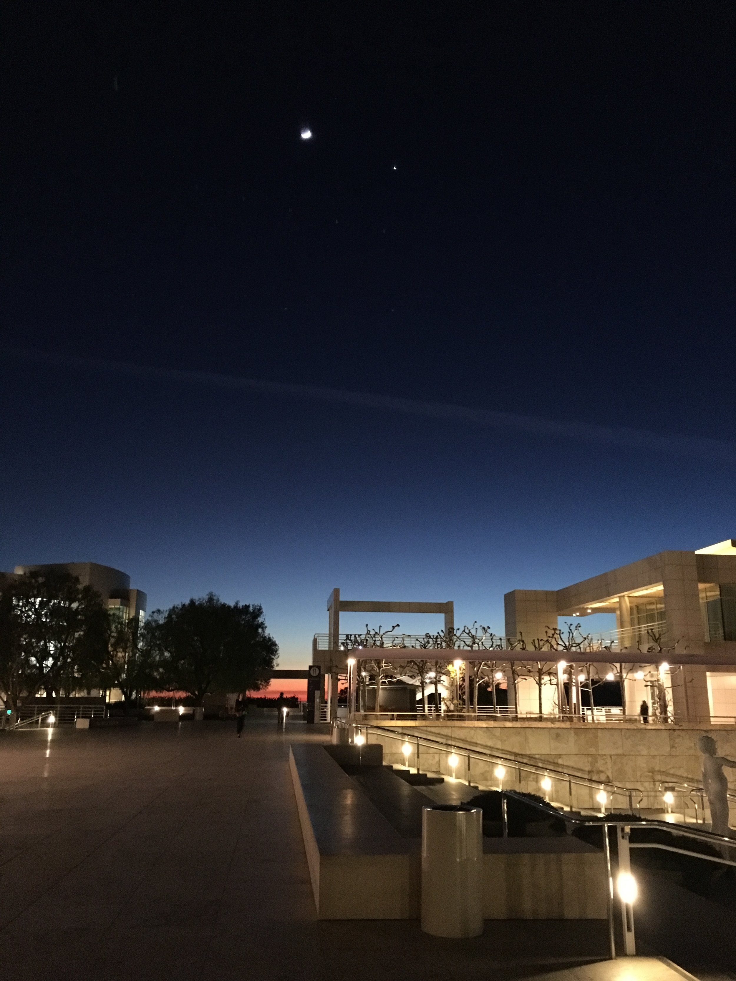 The Ada Louise Huxtable Papers are housed at the Getty Research Institute, part of the Getty Center complex in Los Angeles (Richard Meier & Partners, 1997). This was the scene one evening after a long day in the archives: the sun, the moon, Venus, and, if you look very closely, Orion.  Photo: Christine Cipriani