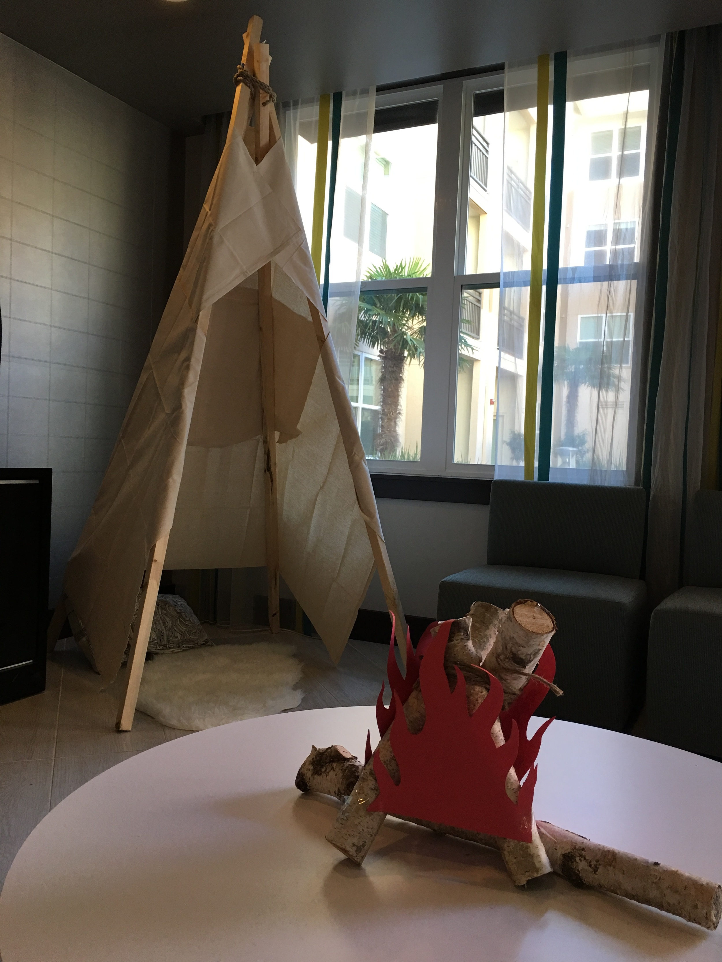Teepee time! a faux campfire made from birch wood and construction paper. A nice touch for the kiddie corner!