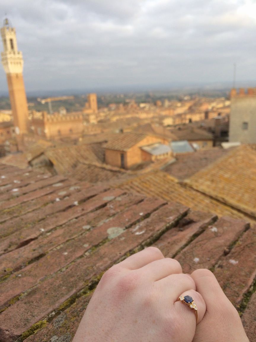 Nate proposed in Siena, Italy, on our first trip out of the country together. I'm totally smitten with the ring he picked out--especially now that it's been resized! :)