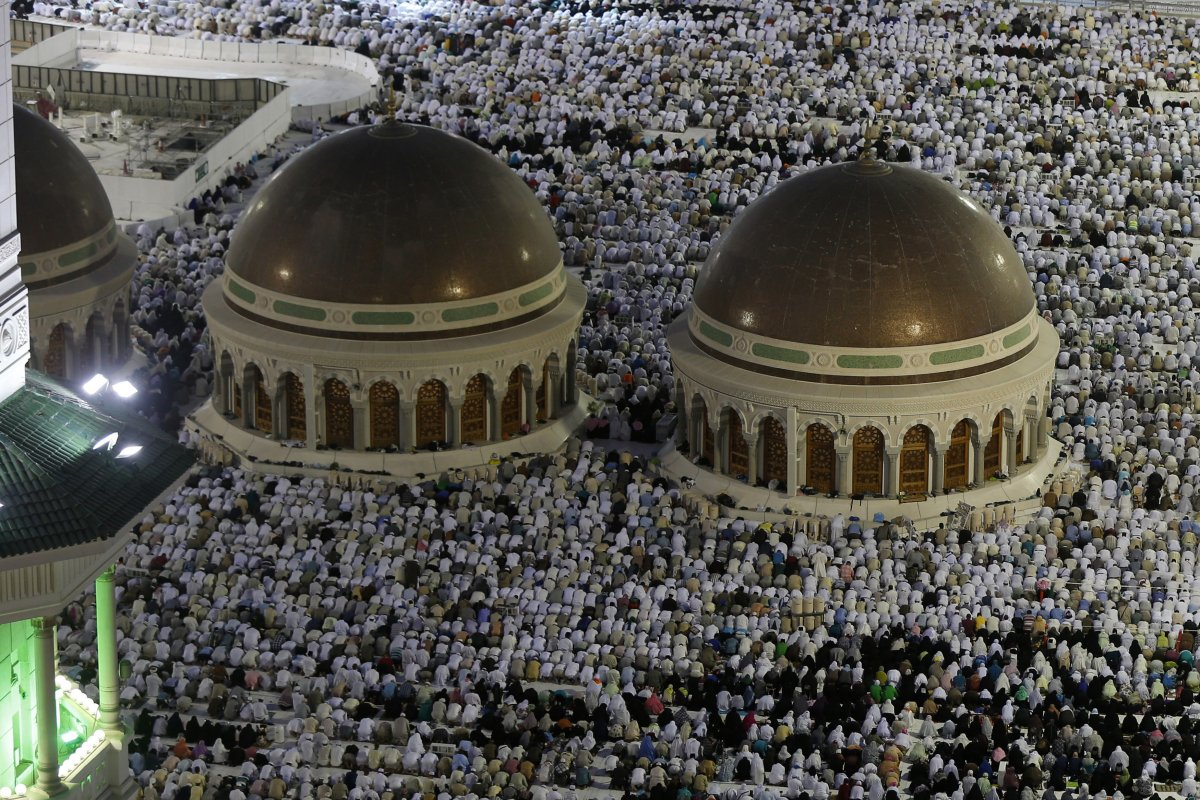Muslim pilgrims pray during the annual Hajj pilgrimage in Mecca, September 27, 2014.
