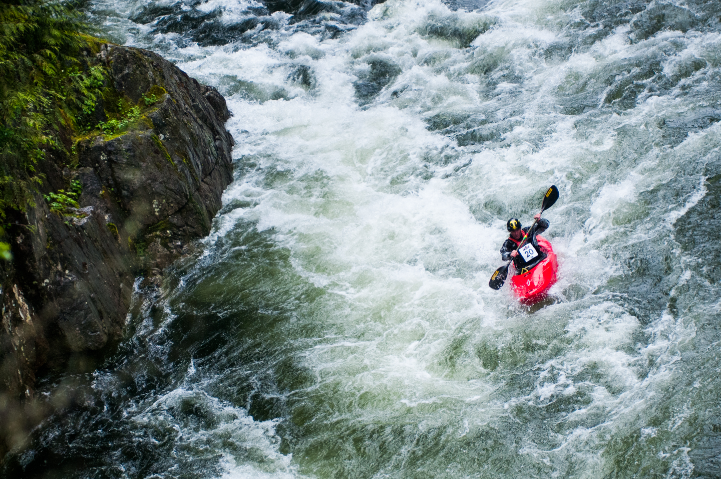 Competitor Kayaker rides the rapids in the third and final leg of the Red Bull Divide and Conquer Race in Vancouver, Canada on the 16th of June, 2012.