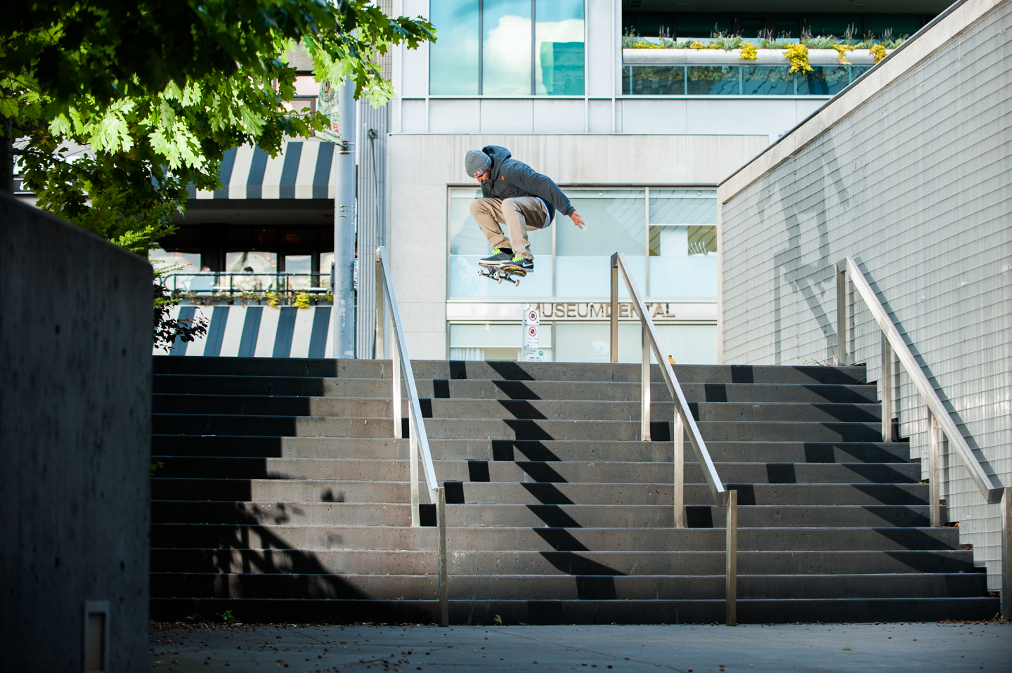 TJ Rogers performs an Ollie down a stair set in Toronto, Canada on October 9th, 2014