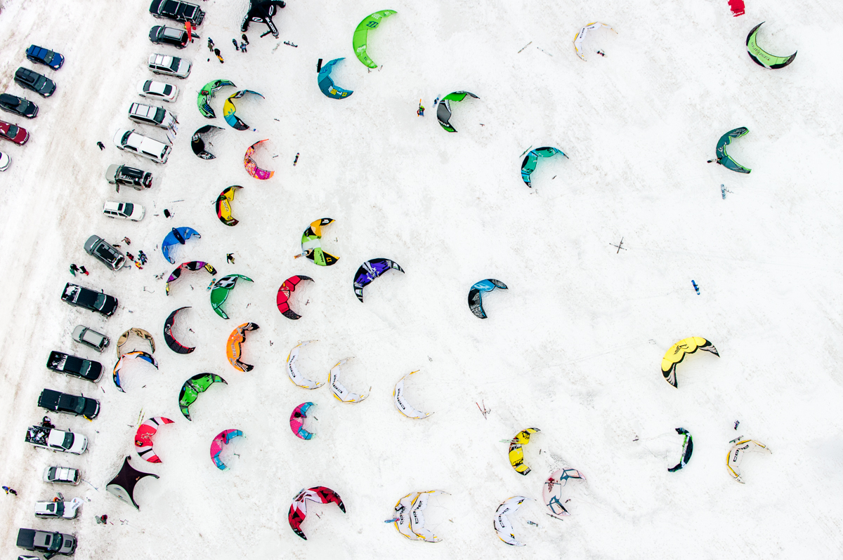 Kites laying on the ground at Red Bull Kite Farm on a field in Regina, Canada on February 15th, 2015