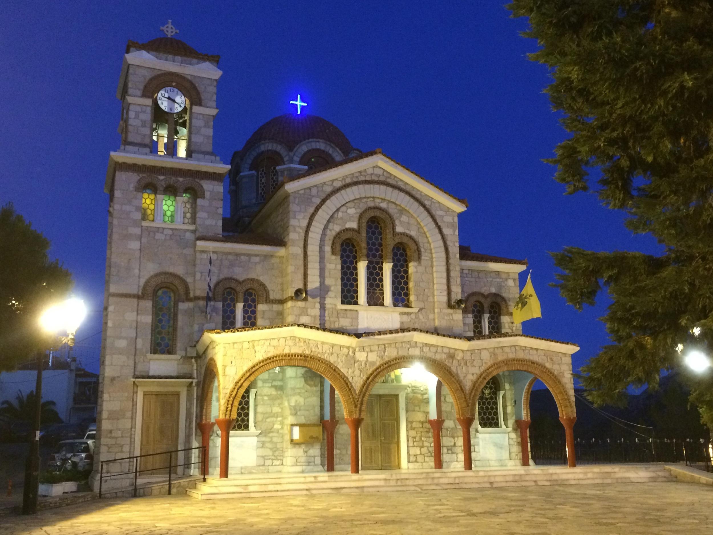 Church in Delphi at night. Rad cross.