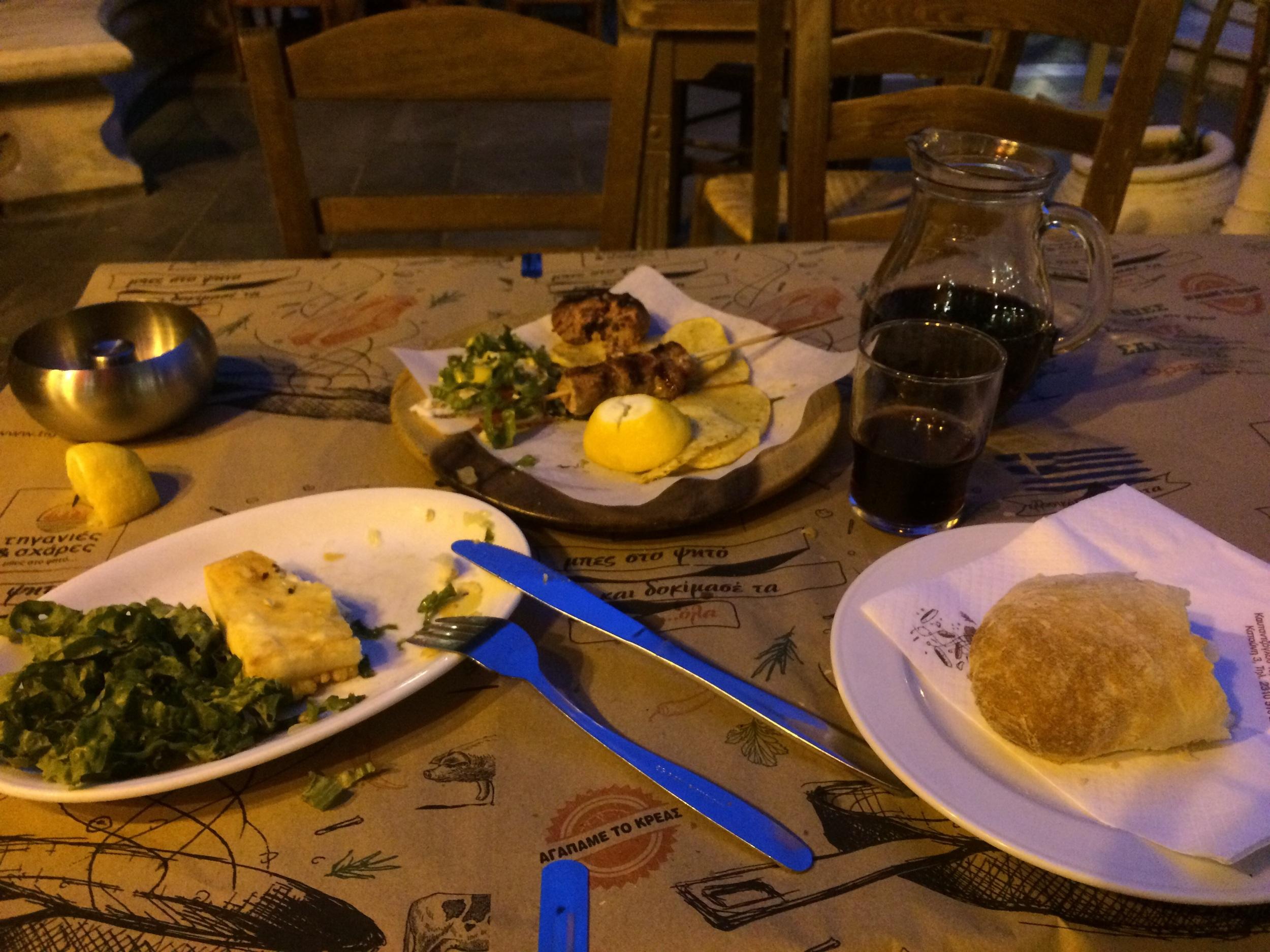 Meatball, souvlaki, saganaki, demi-sweet wine, bread
