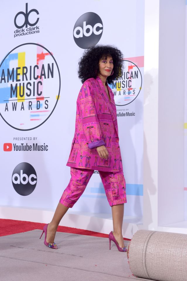 PHOTO: GETTY  Always a pink moment! She wore Amsterdam-based designer Selam Fessahaye pink suit with Egyptian hieroglyphics to the AMAs rehearsals paired with pink Jimmy Choos.
