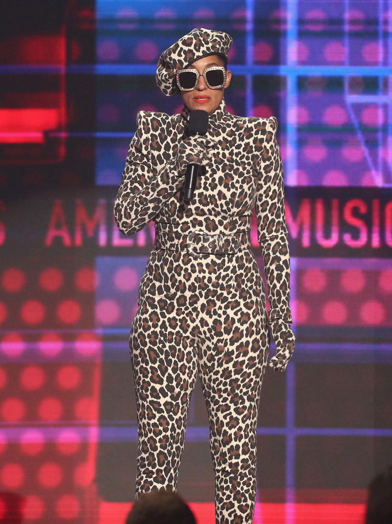 PHOTO: GETTY  Sergio Hudson Leopard Print jumpsuit with a matching beret. Oversized Gucci glasses seal the look.