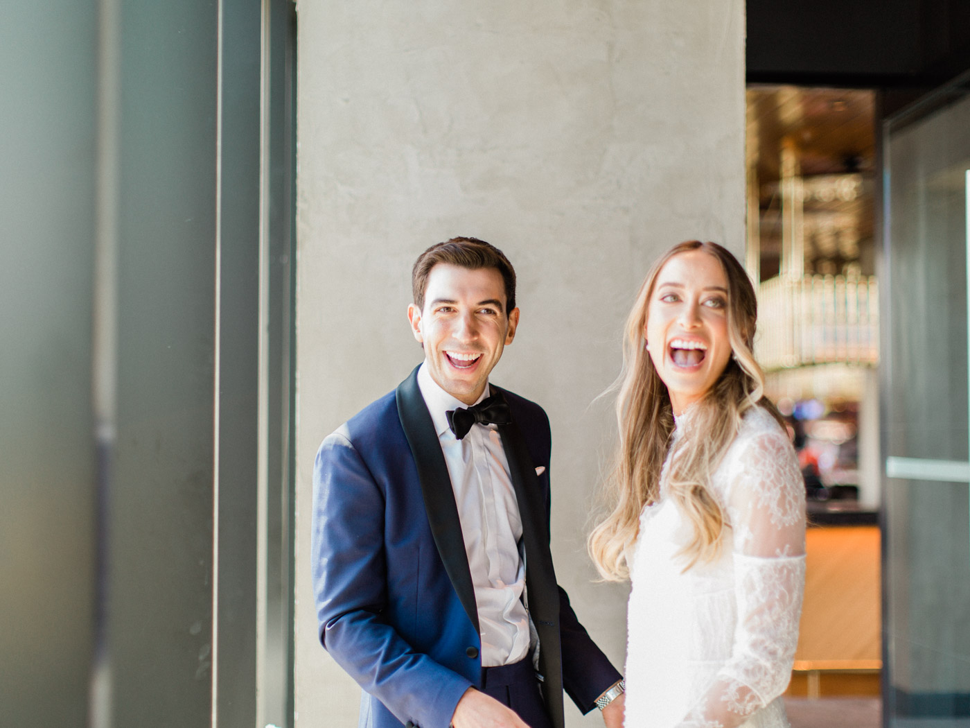-Candid, natural first look between bride and groom at restaurant wedding Chez Lavelle.  Captured by Toronto wedding photographer Corynn Fowler Photography.
