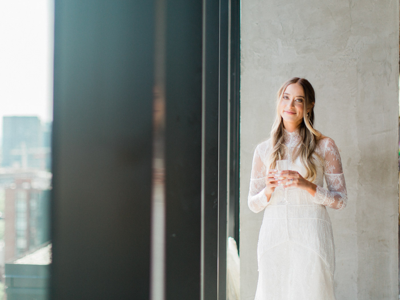 -	Candid, natural first look between bride and groom at restaurant wedding Chez Lavelle.  Captured by Toronto wedding photographer Corynn Fowler Photography.