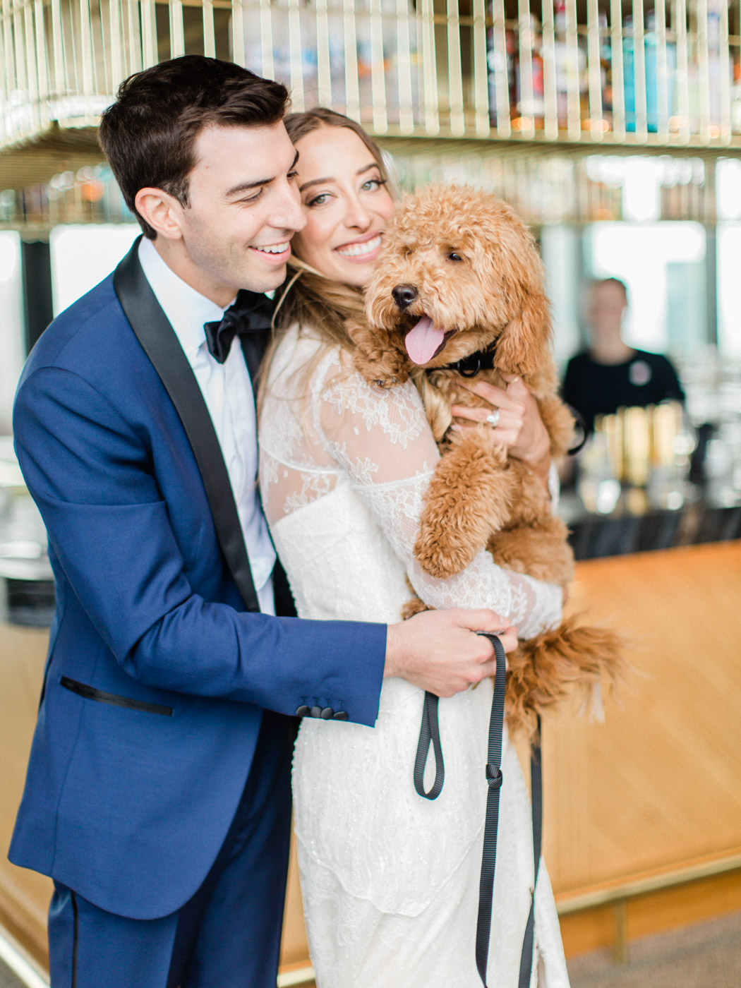 -	Bride, groom , and puppy at vogue styled wedding in downtown Toronto.  Captured by Toronto wedding photographer, Corynn Fowler Photography.